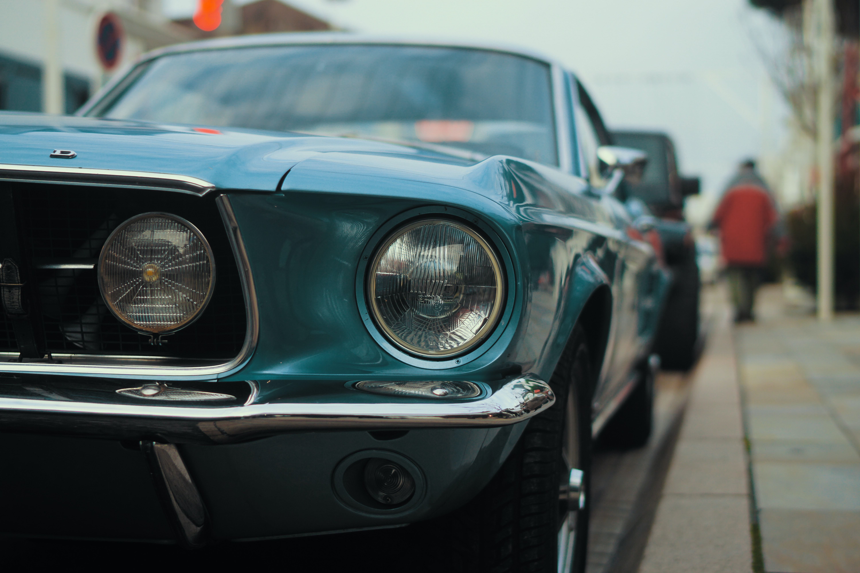 selective focus photo of blue car