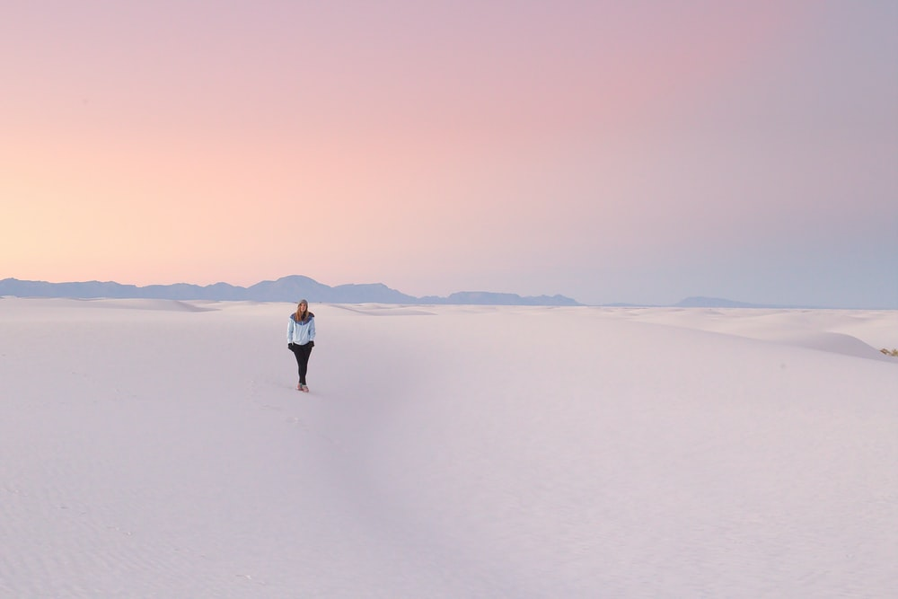 person standing in middle of snow field