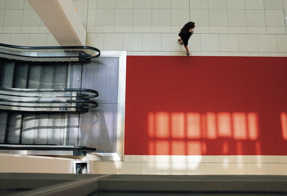 woman walking near elevator inside building