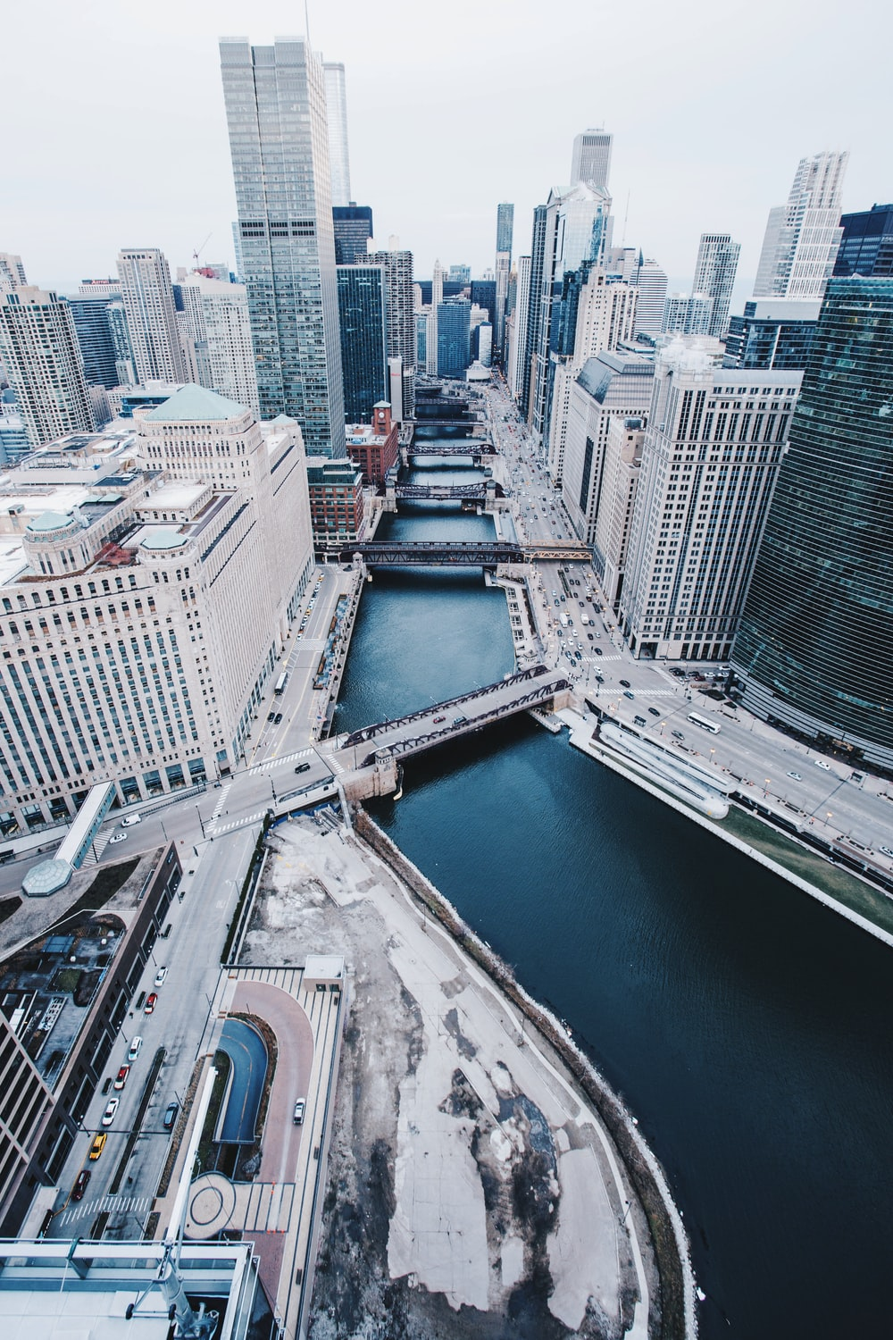 aerial view photography of city buildings with body of water