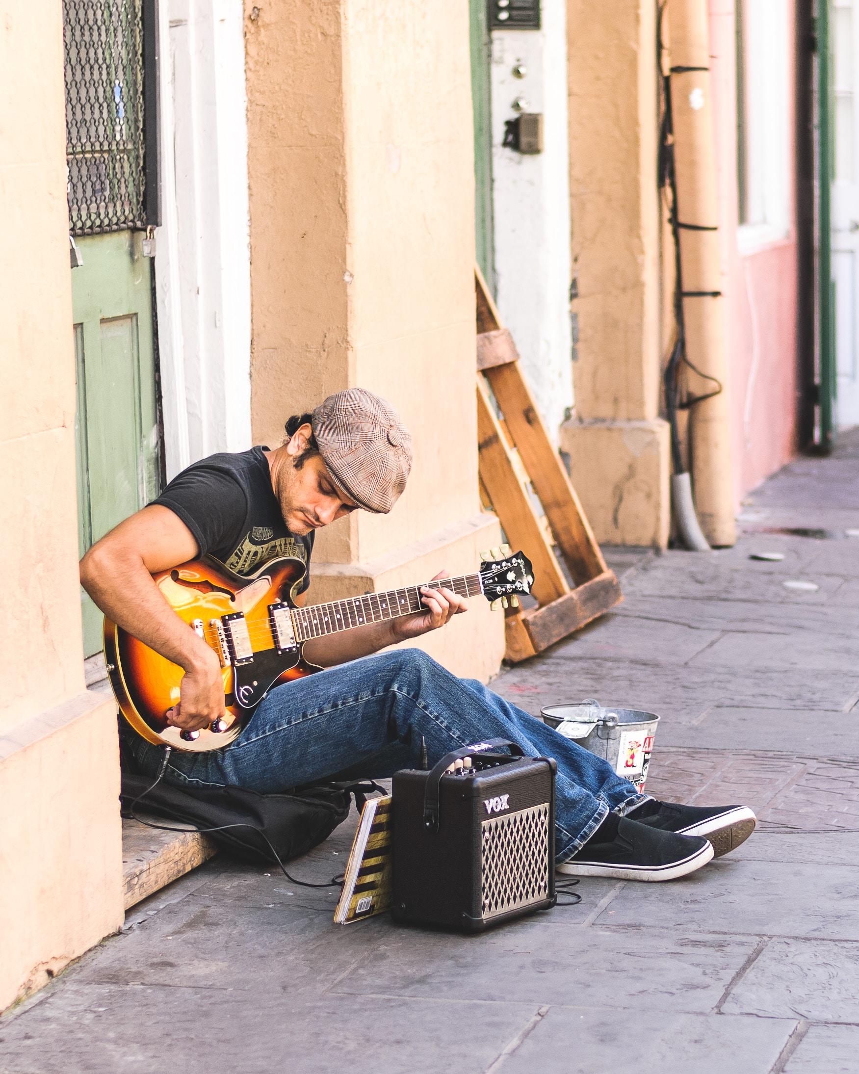 photo of man playing electric guitar