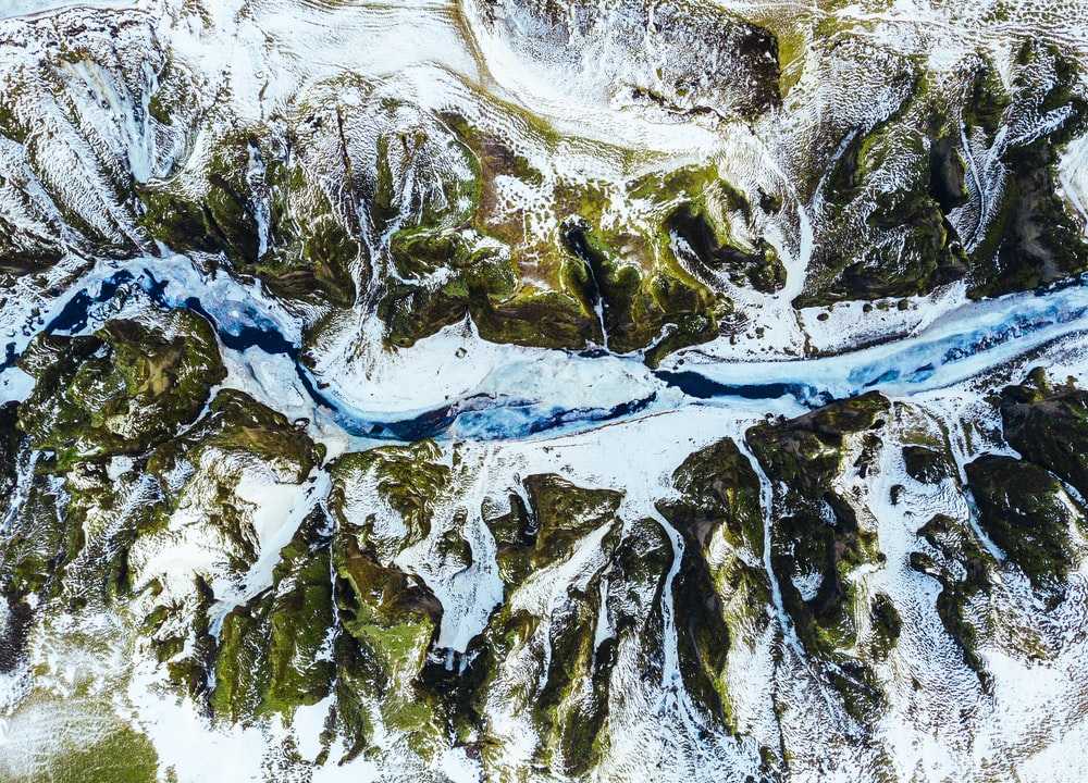 aerial photograph of river and mountain