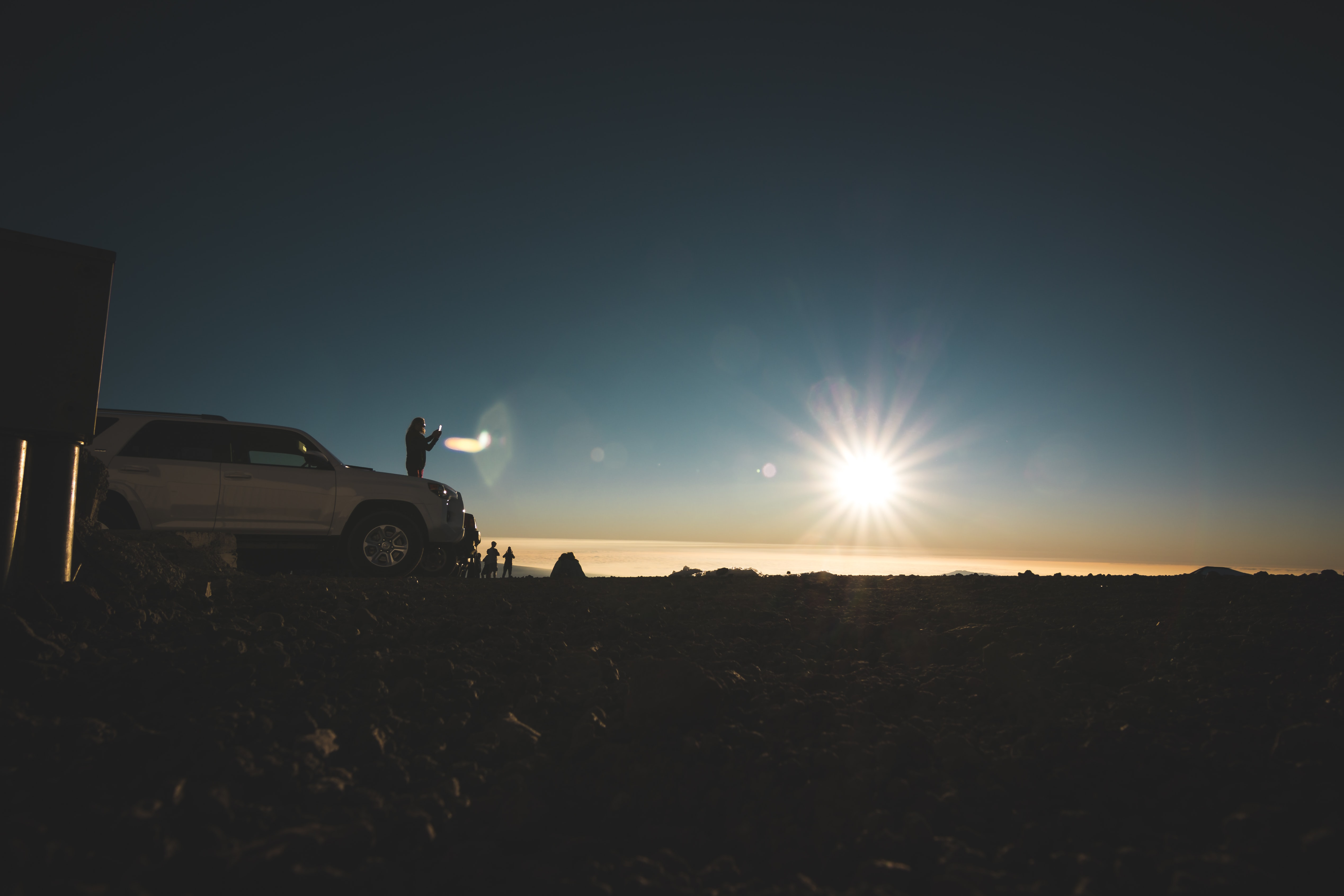 white car parked during sunset