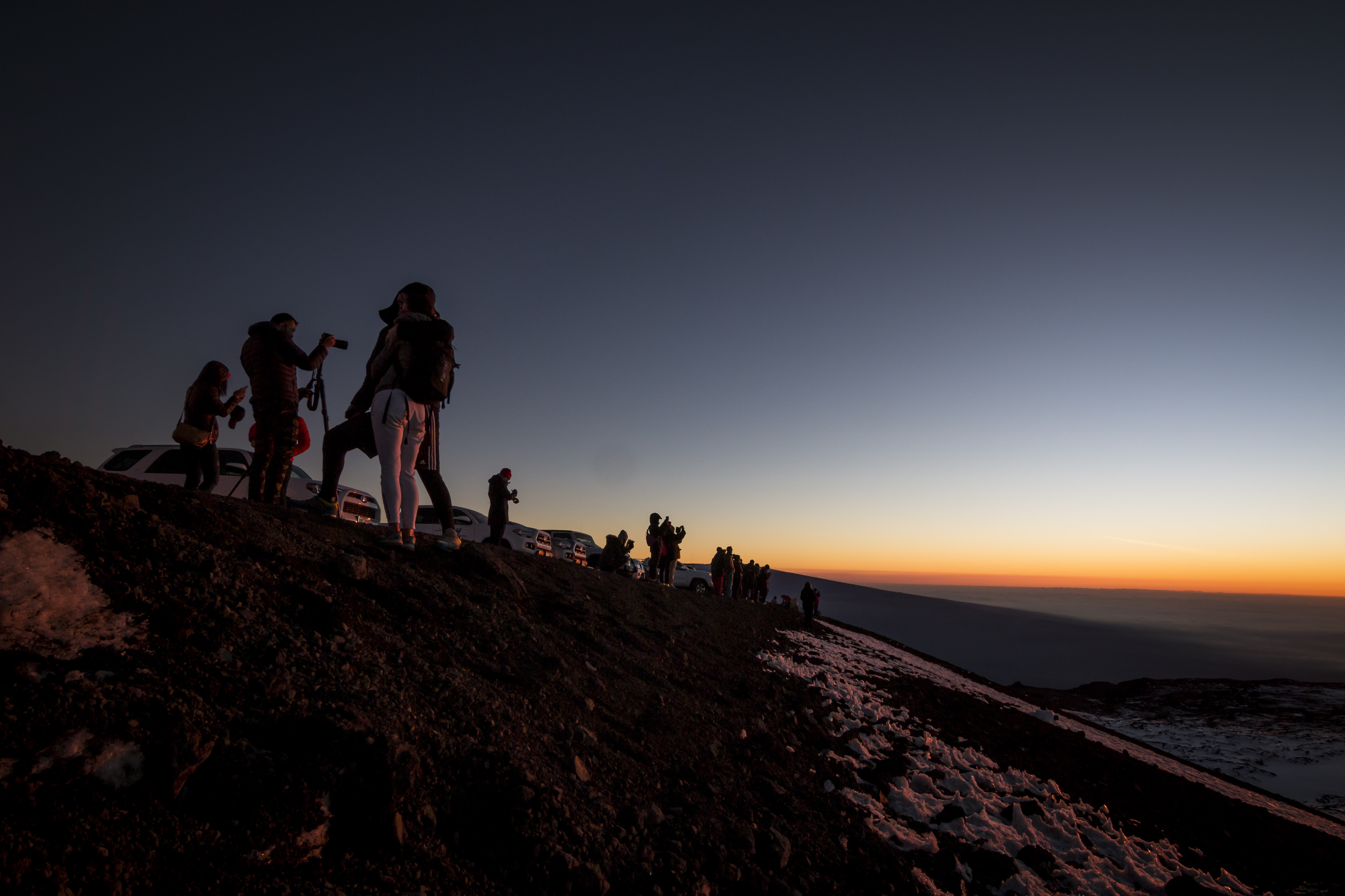 photo of people on top of the mountain