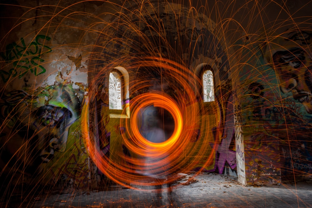 steel wool photography of person in room