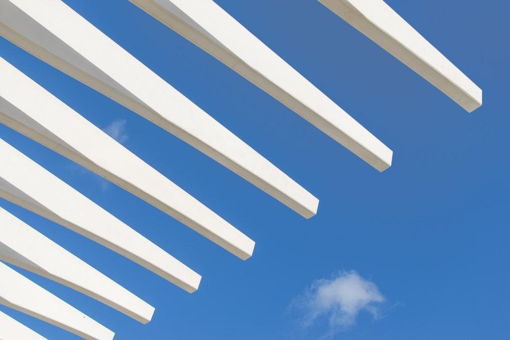white wooden gondola under blue sky