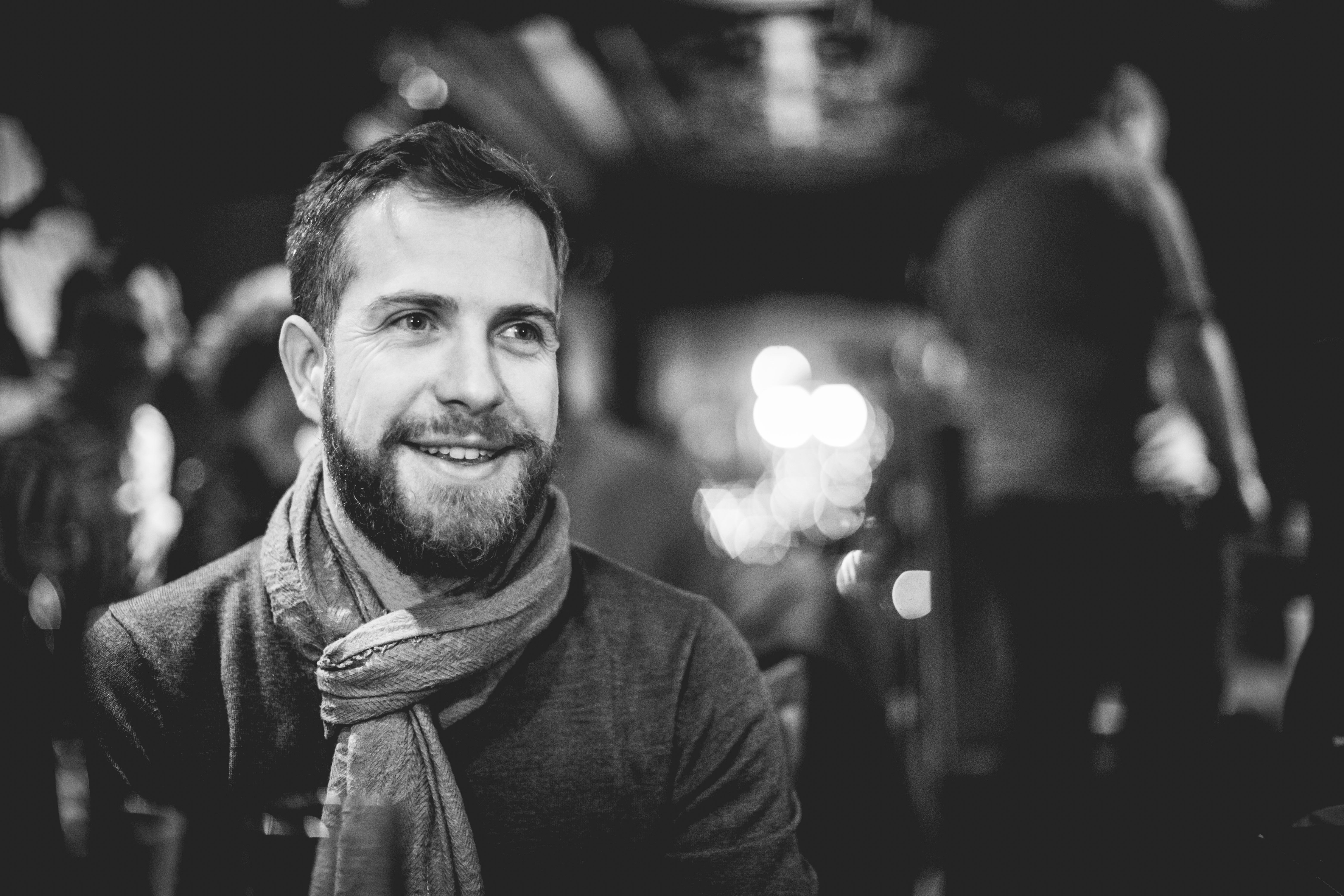 grayscale photography of man with scarf