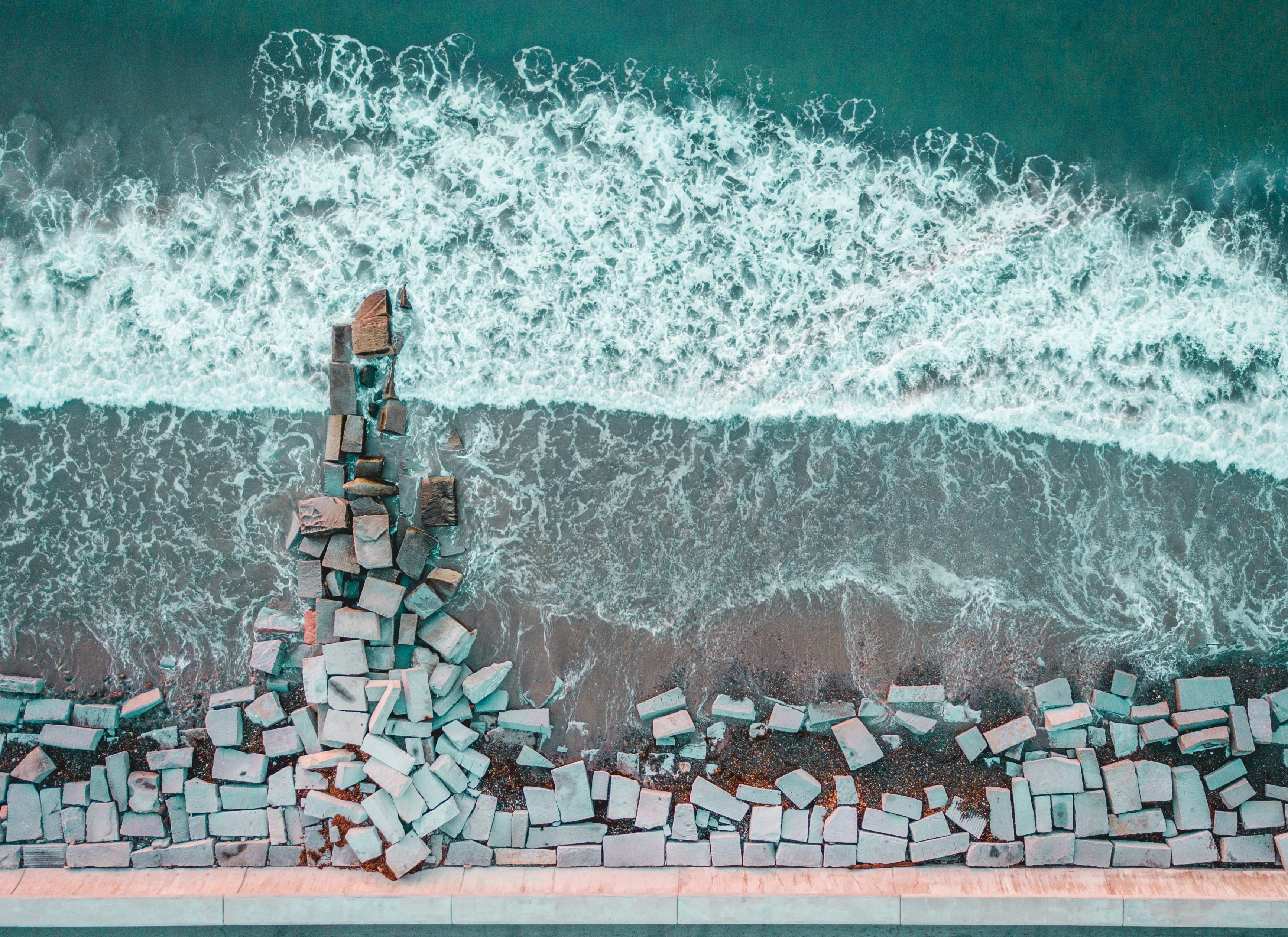 bird's-eye view photography of stone bricks on seashore