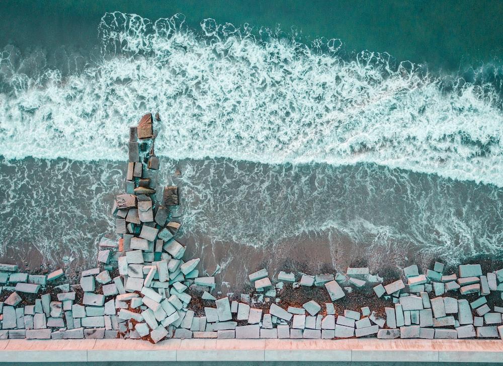 bird's-eye view photography of stone bricks on seashore