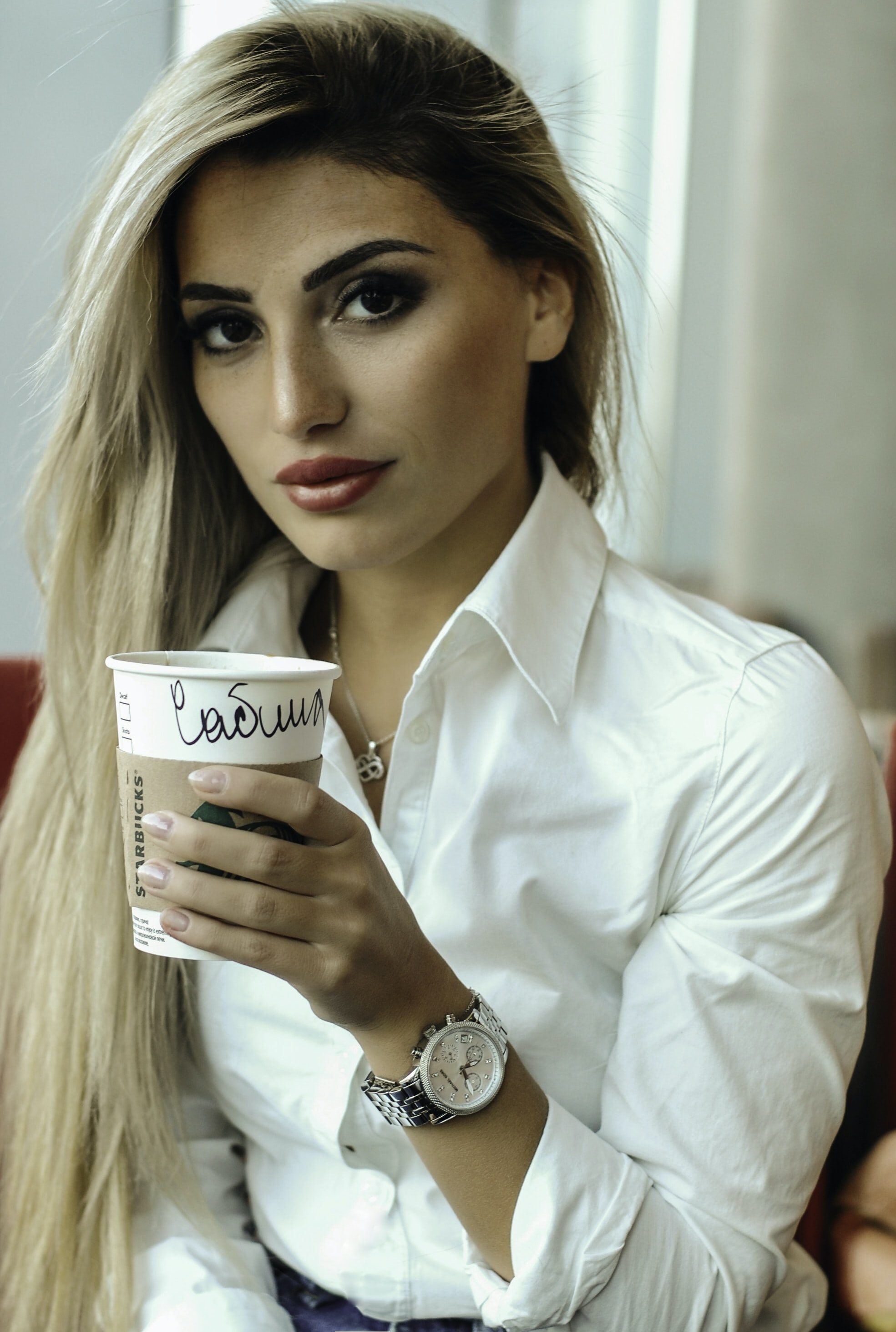woman holding Starbucks cup
