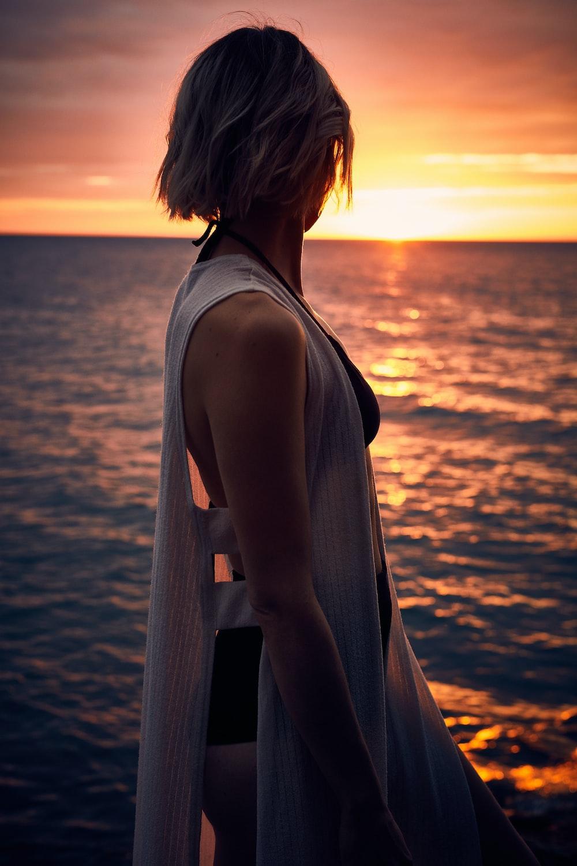 woman facing sideways at sunset