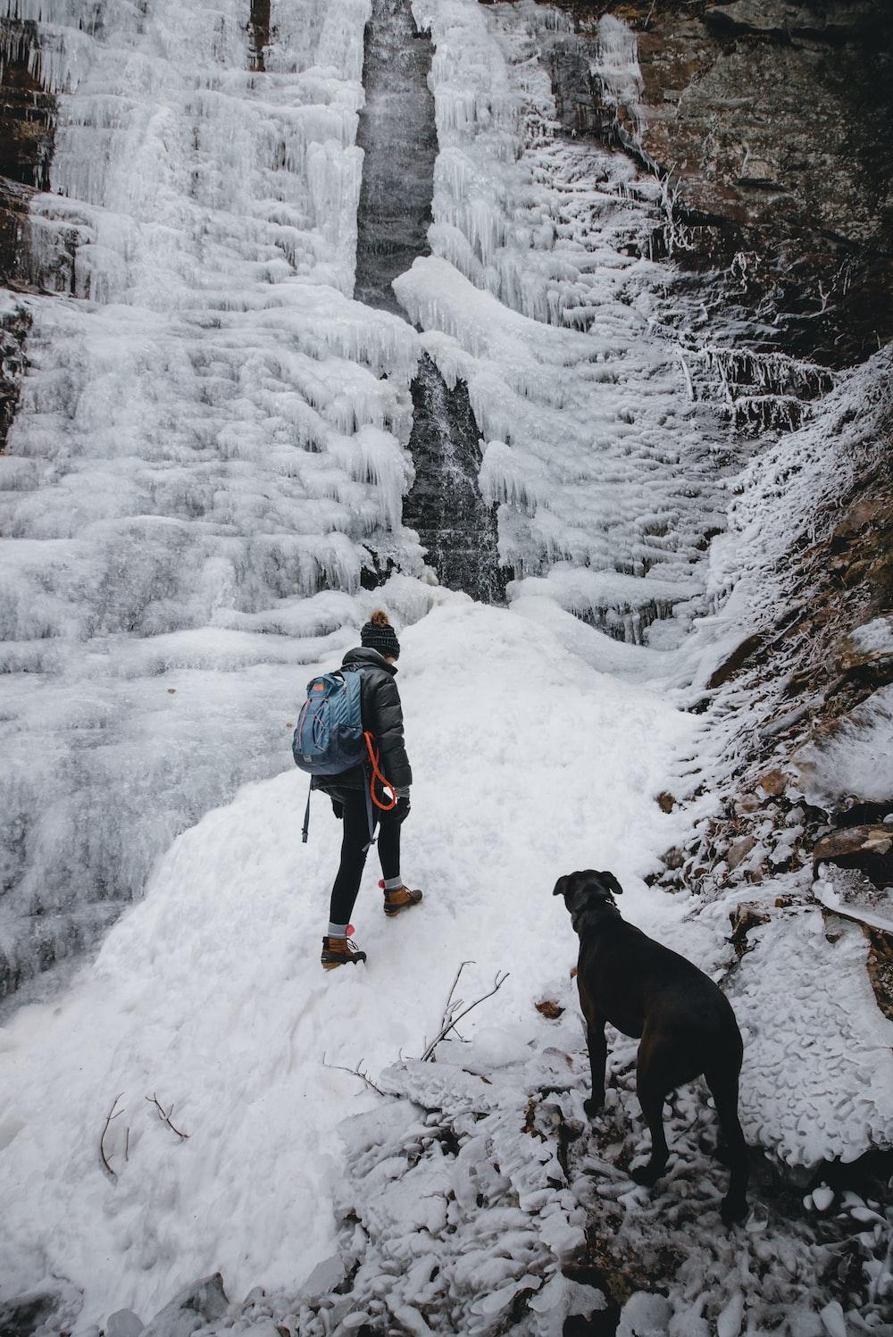 woman climbing through mountain