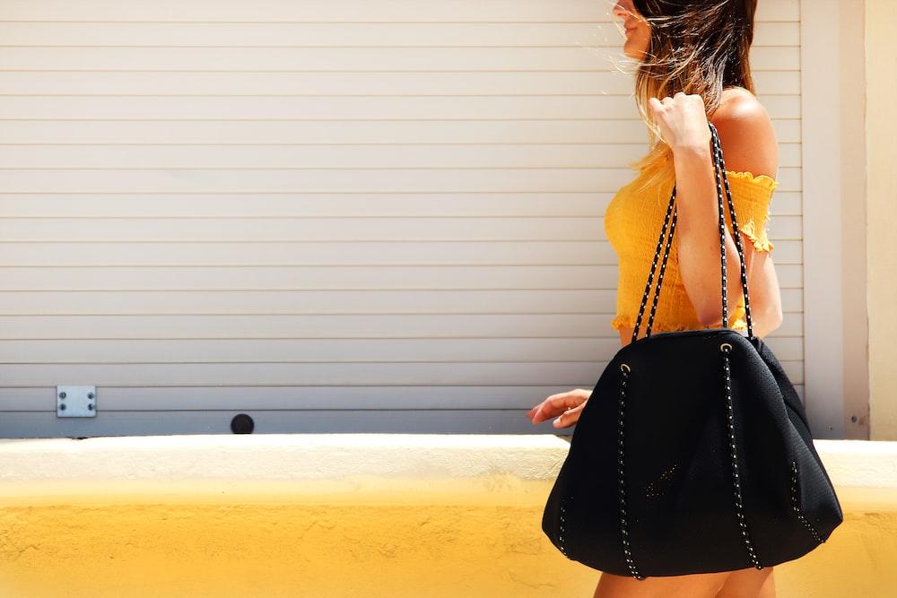 woman carrying crossbody bag