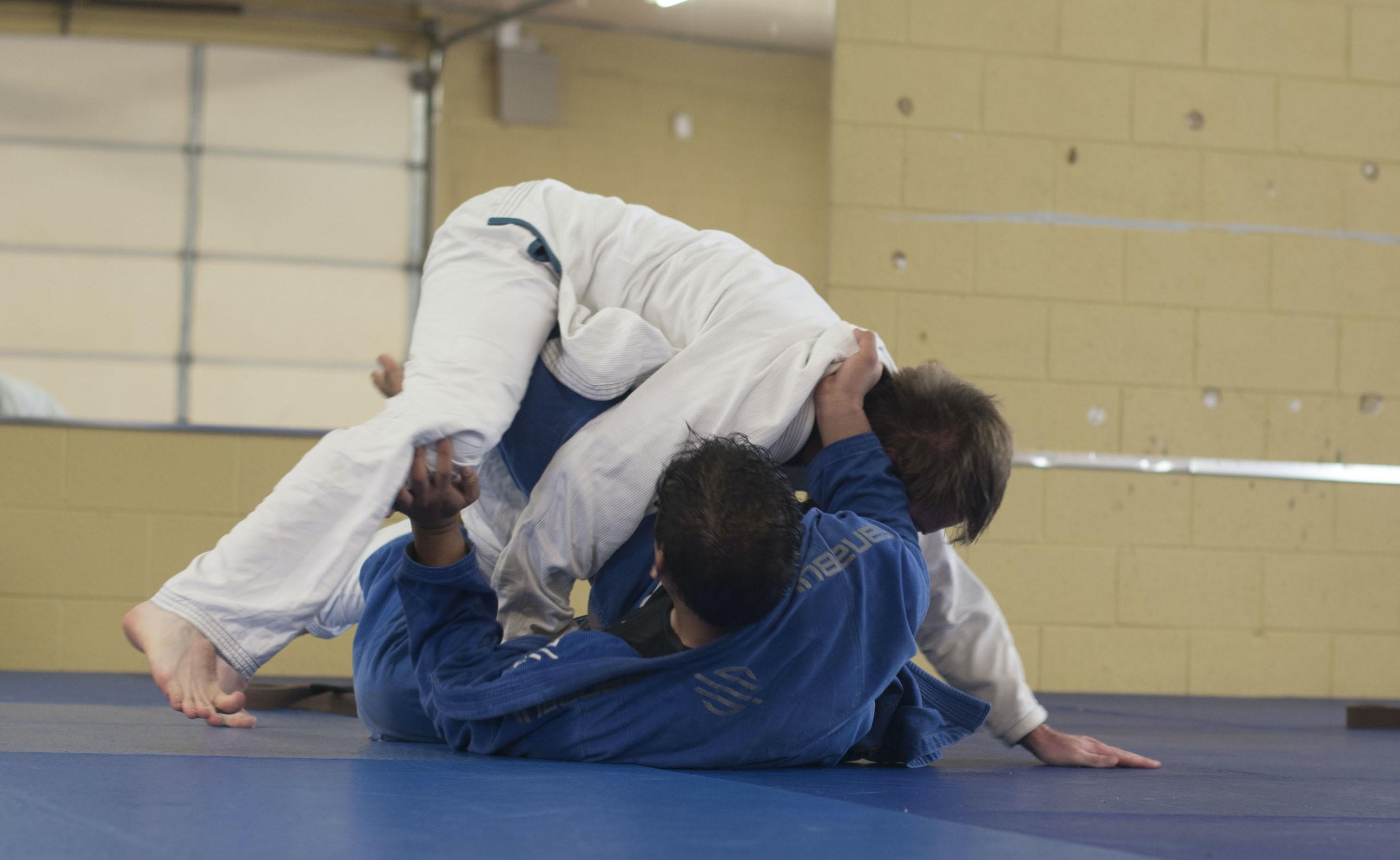 photo of two man wearing Taekwondo suit
