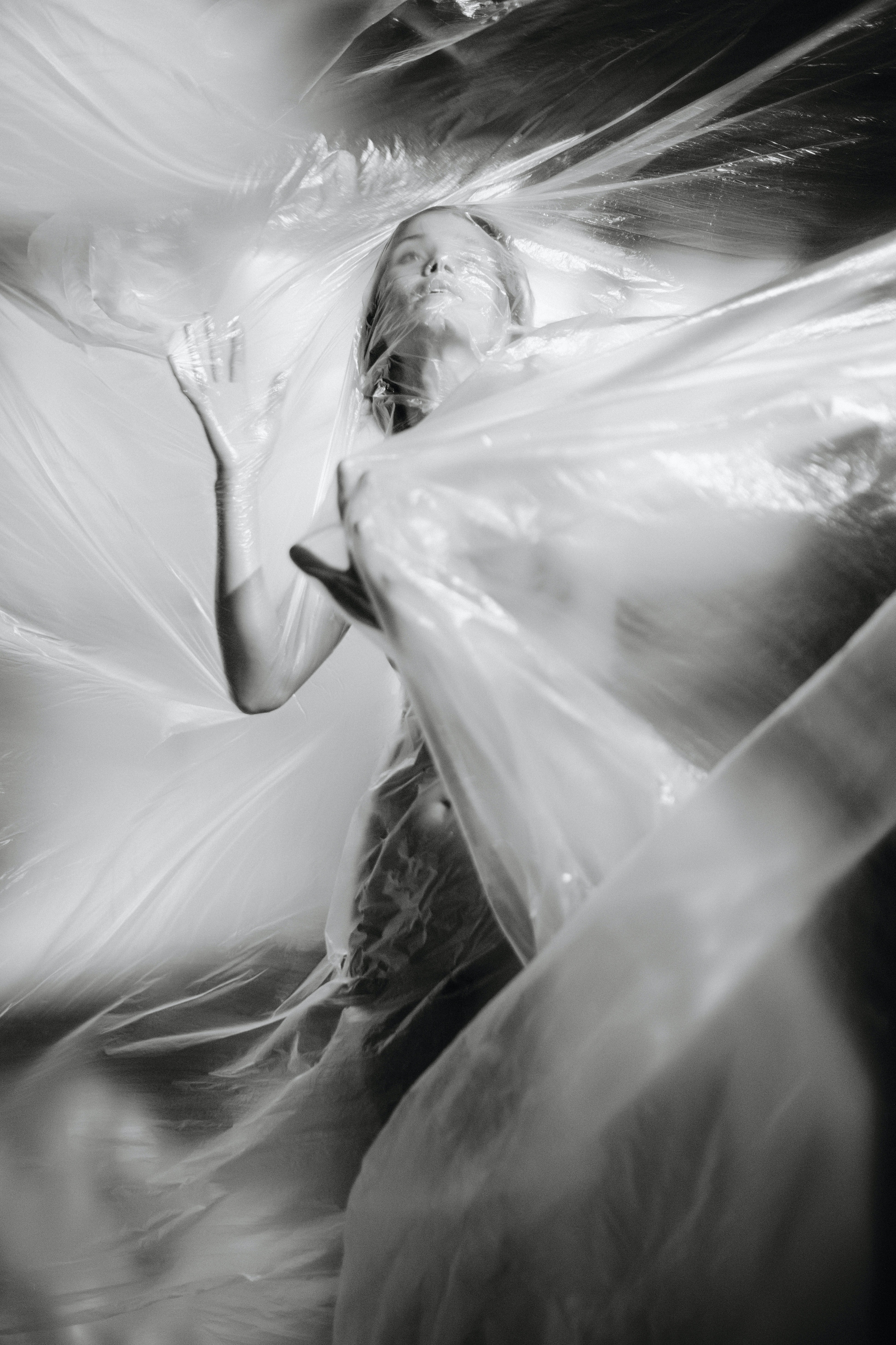 grayscale photography of woman covered in plastic