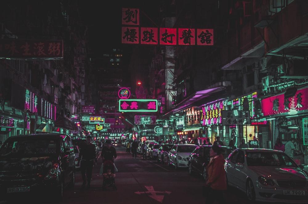 several people walking on street during nighttime