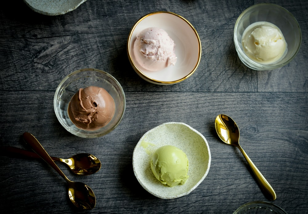 four ice creams on cups