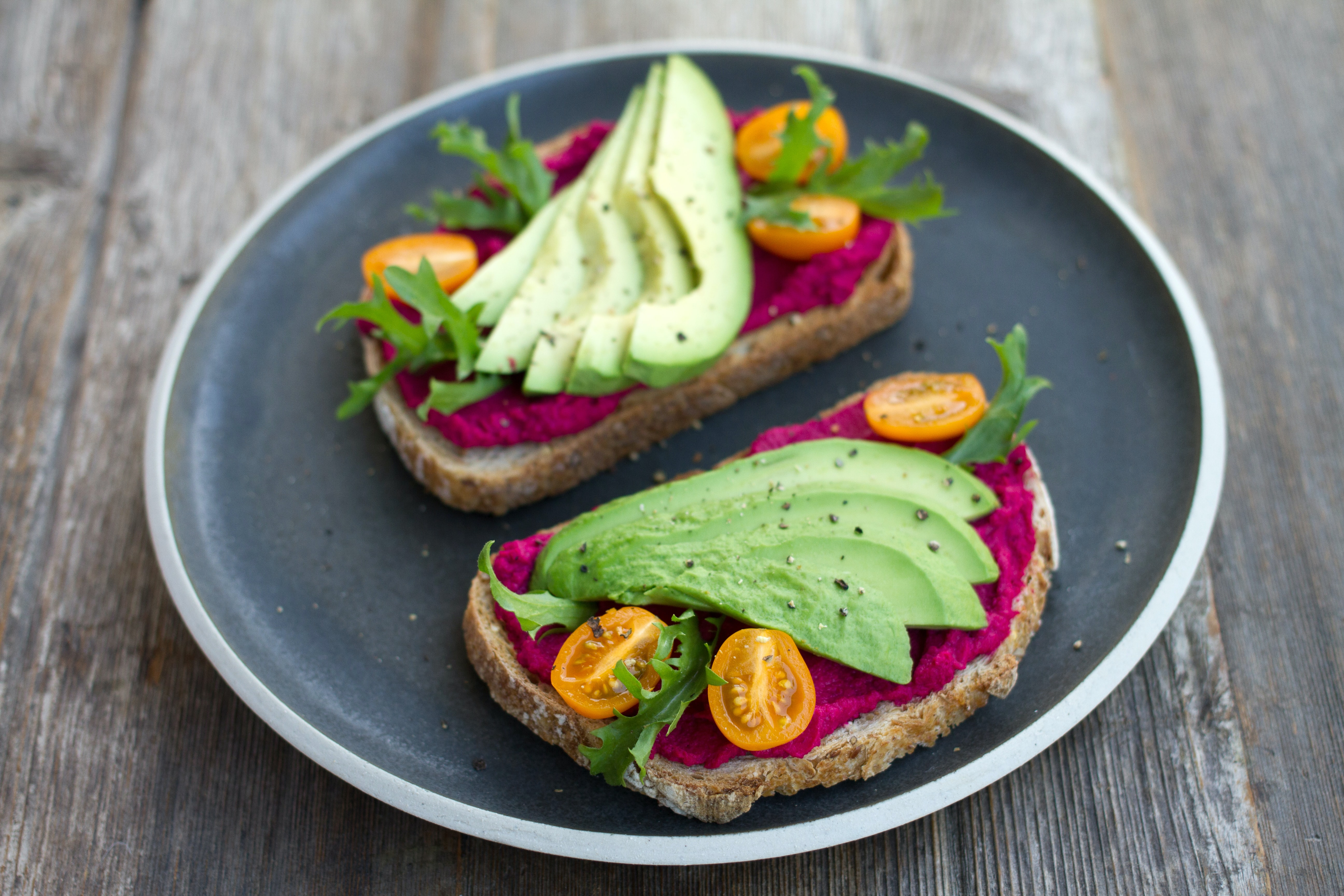 two sliced breads with avocado on top