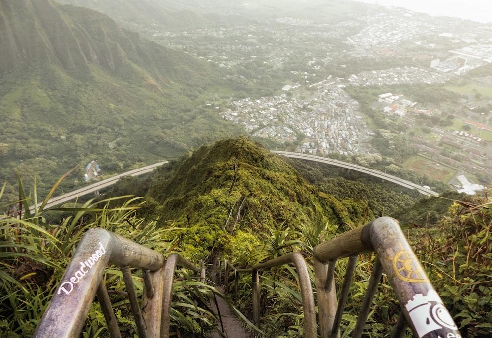 photo of man green mountain
