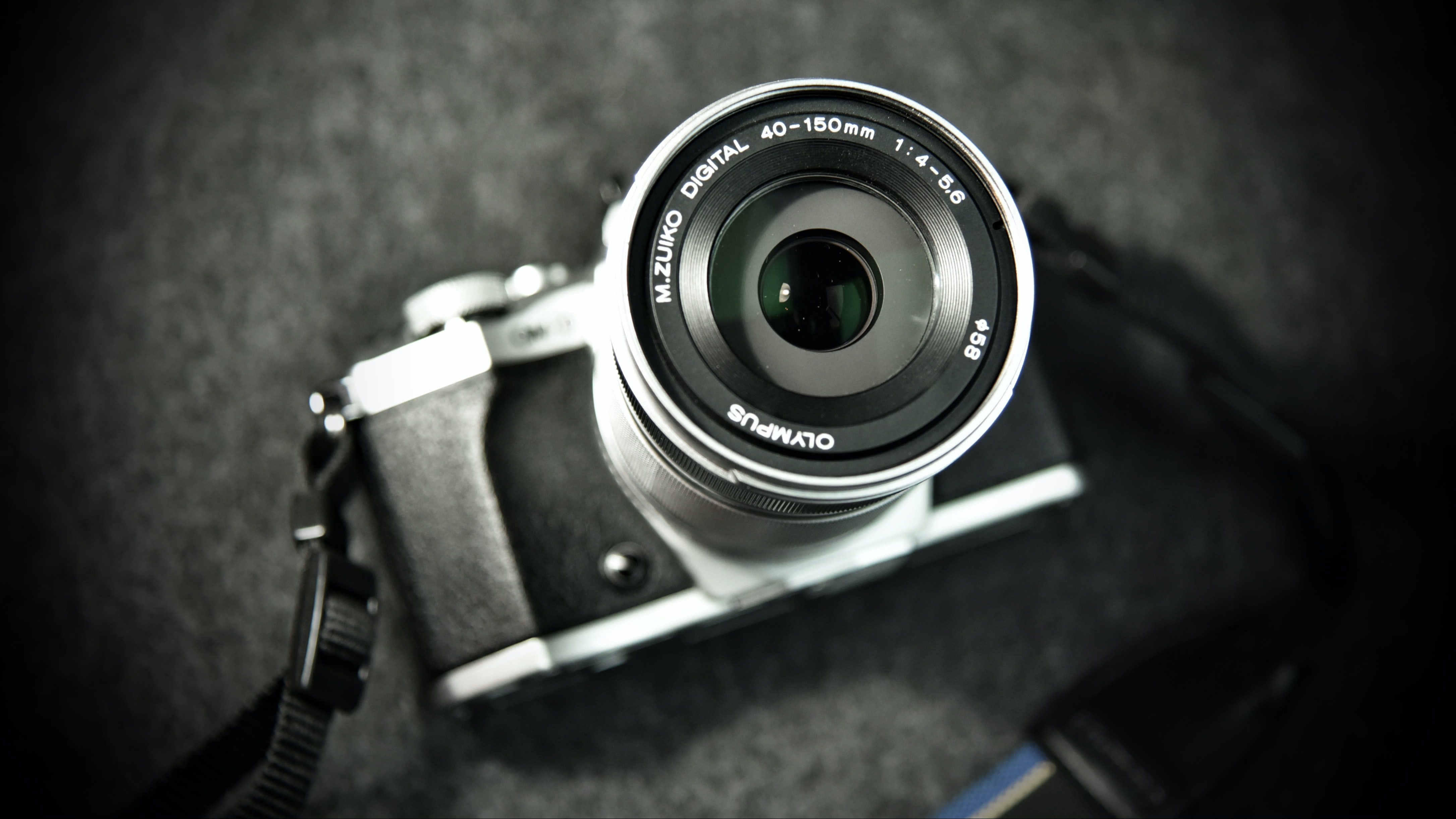 grayscale photography of DSLR camera on gray surface
