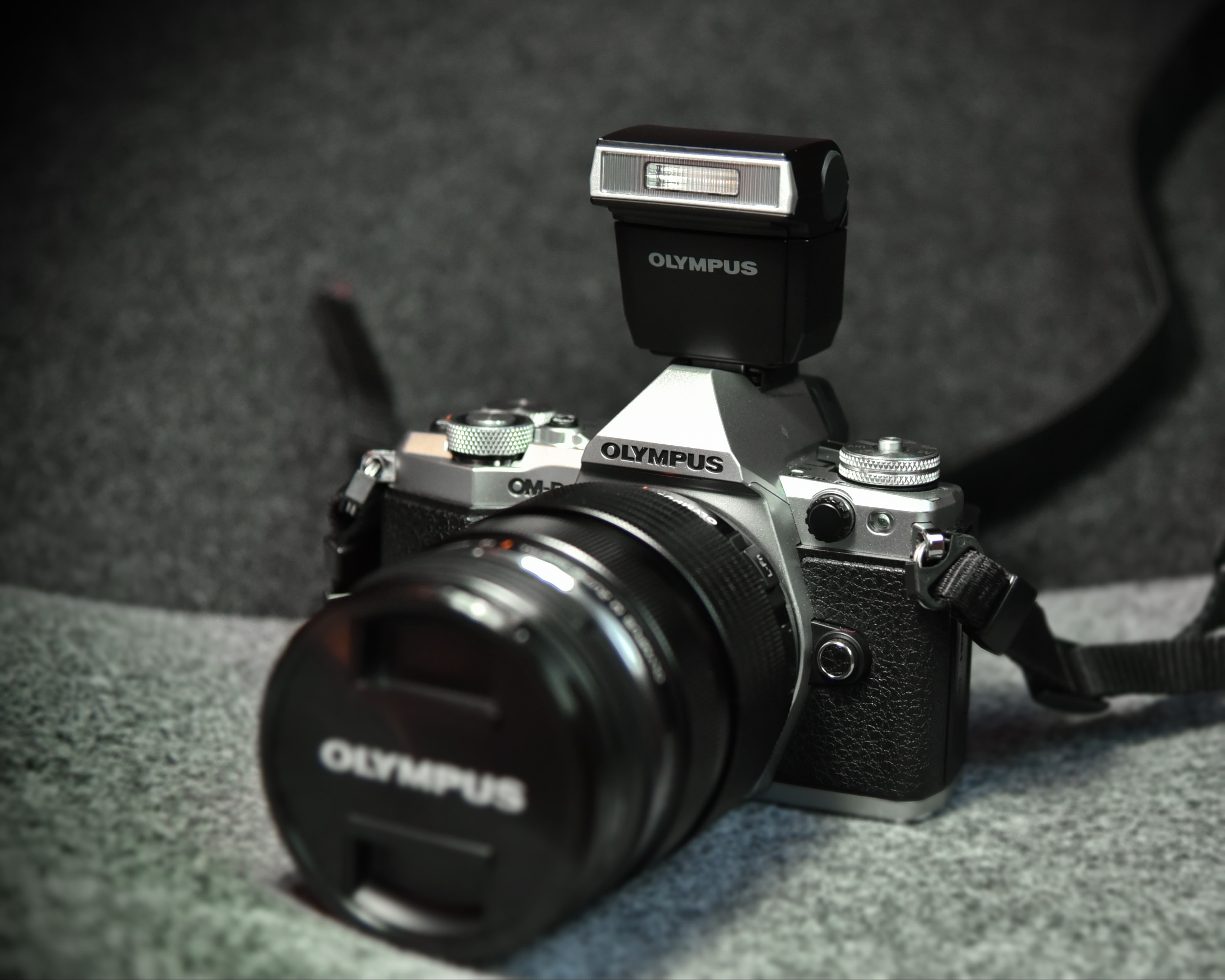 black and grey Olympus camera