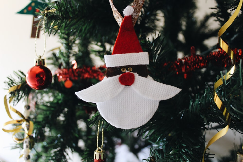 white and red Santa Claus head Christmas bauble