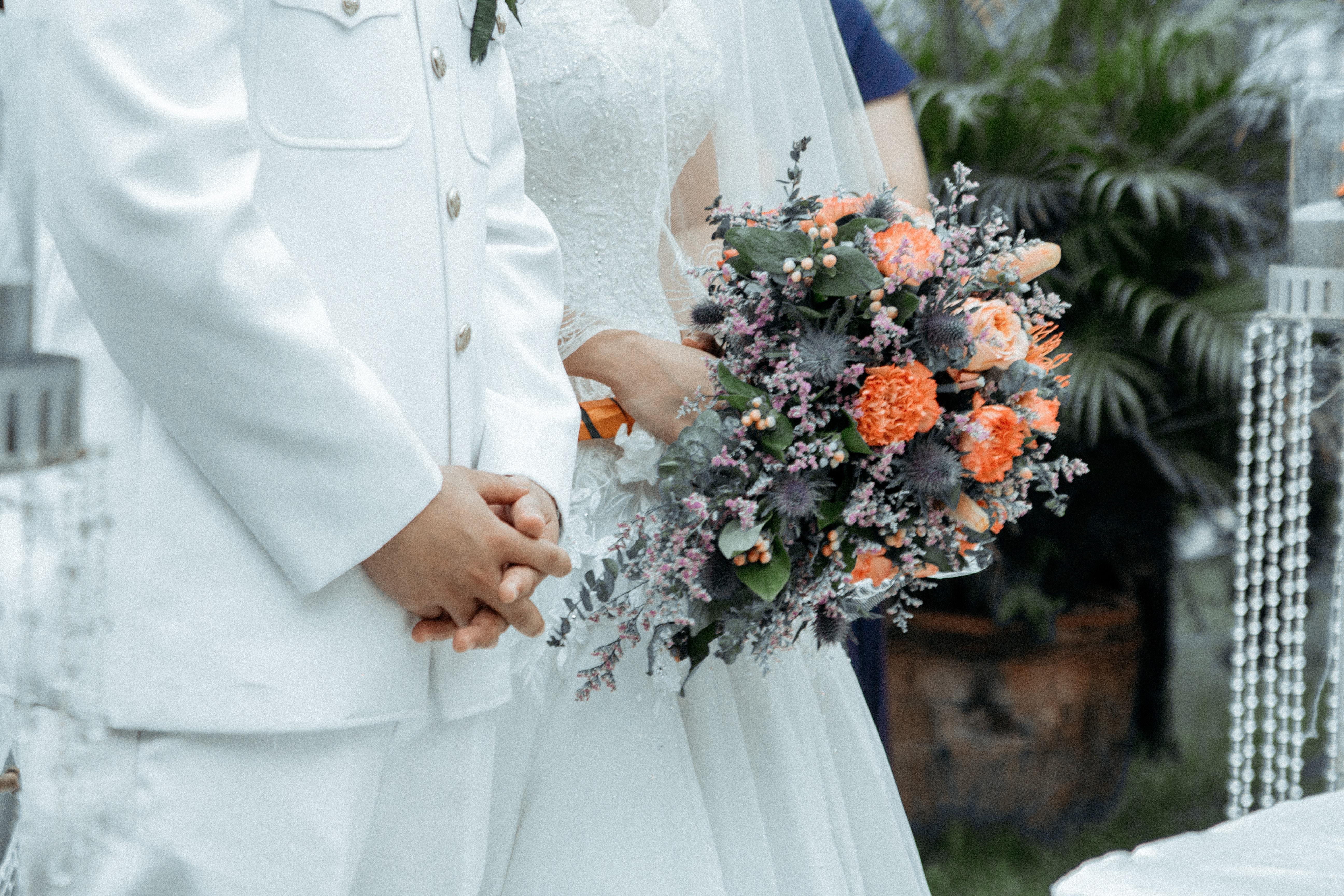 woman holding bridal bouquet