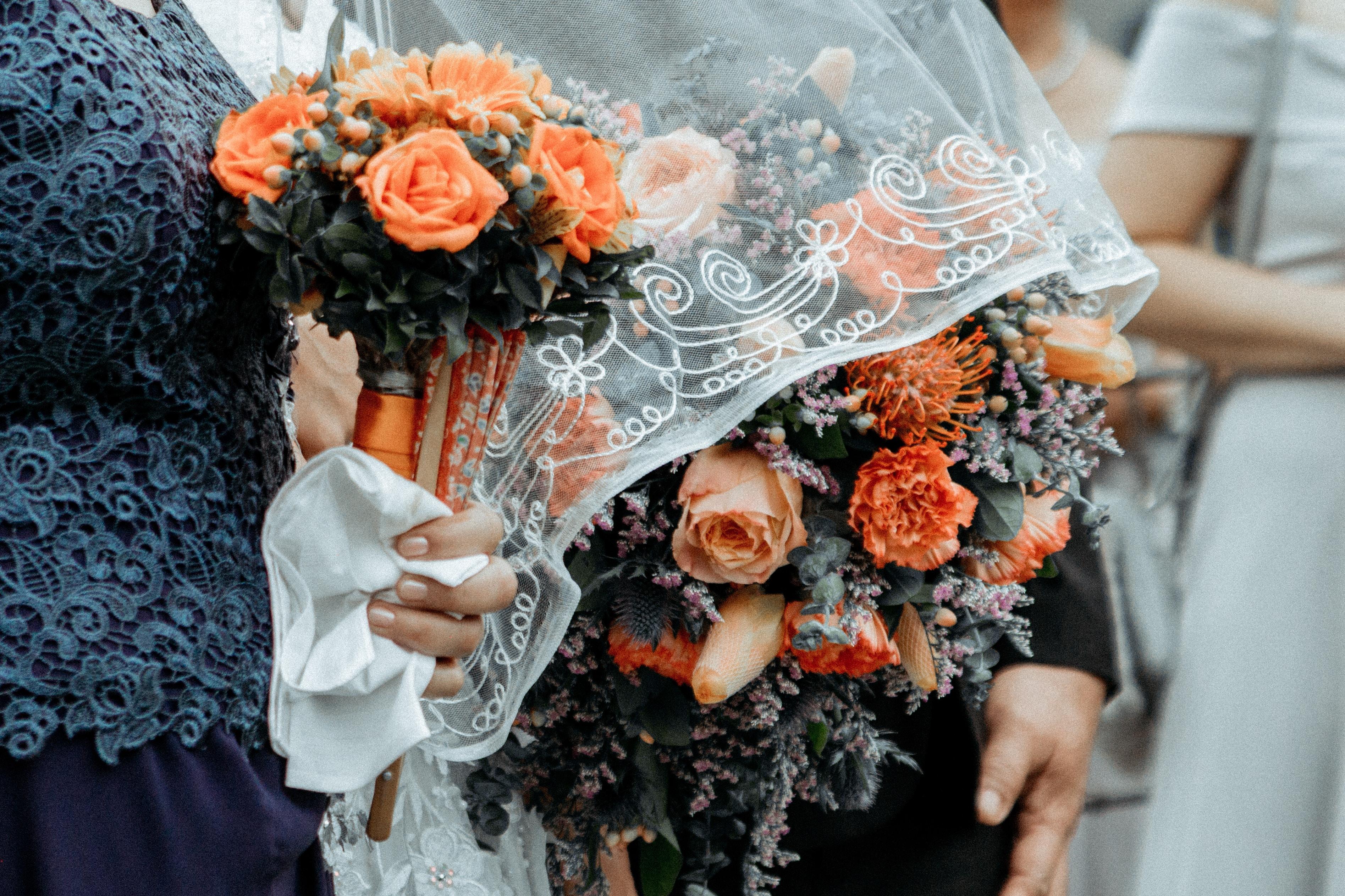 person holding flower bouquet