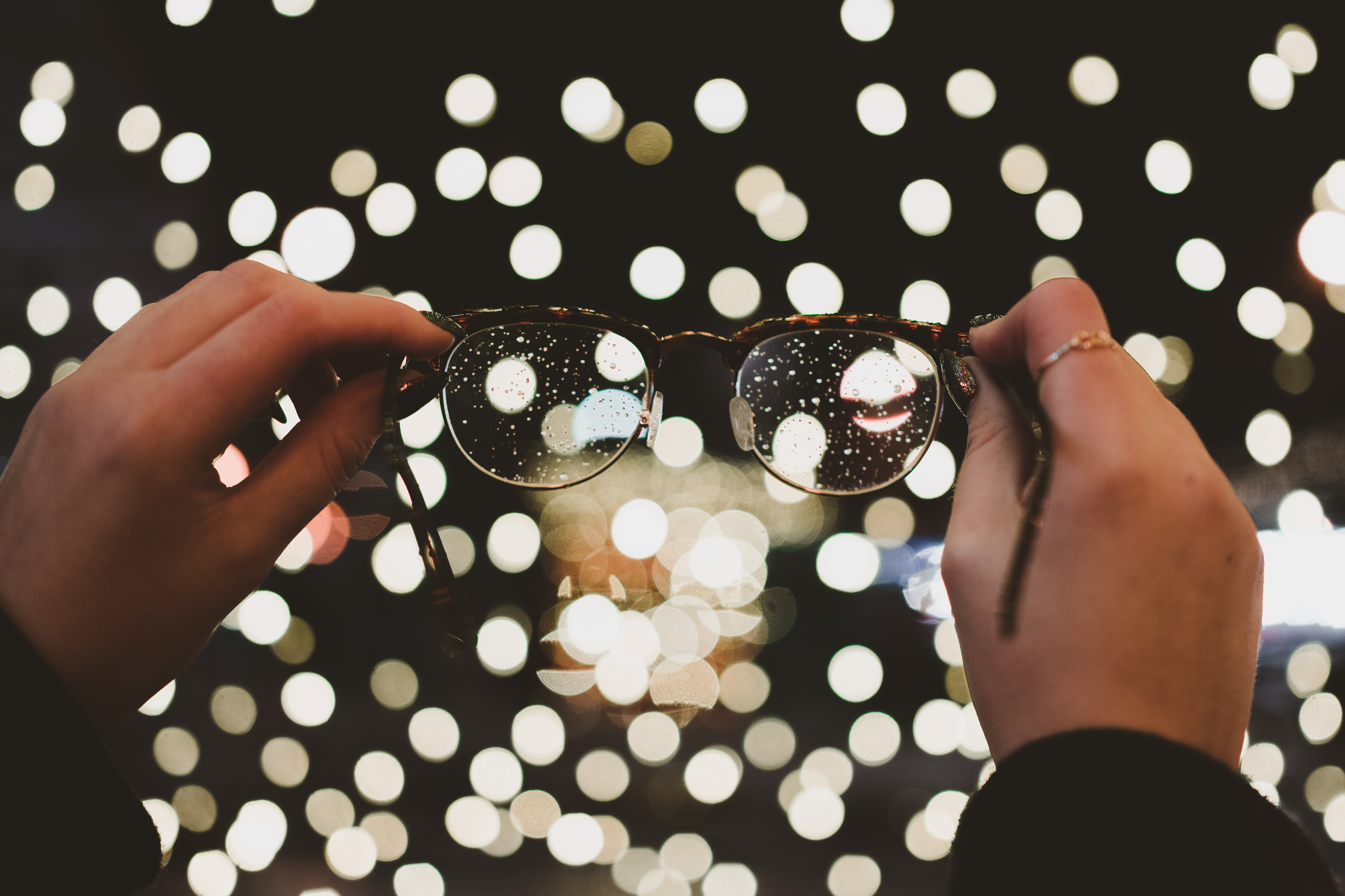 bokeh photography of eyeglasses