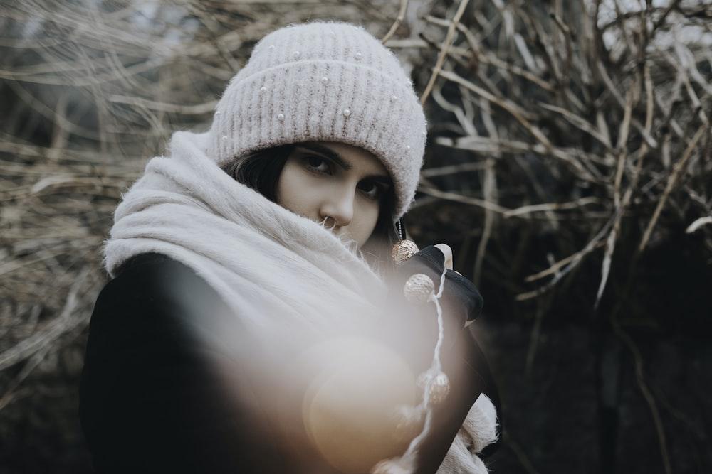 woman wearing gray knit hat