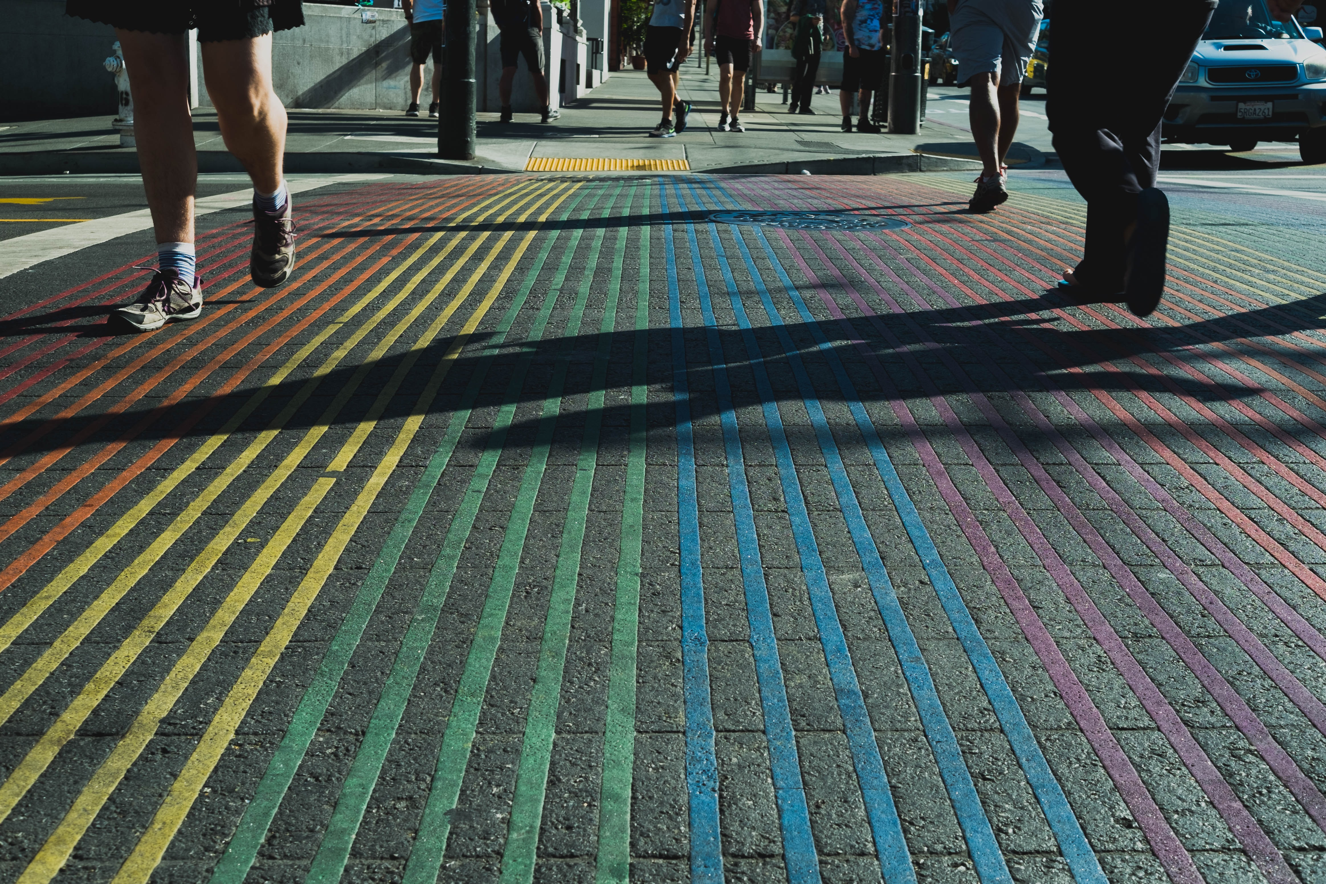 people walking on multicolored pinstriped ground