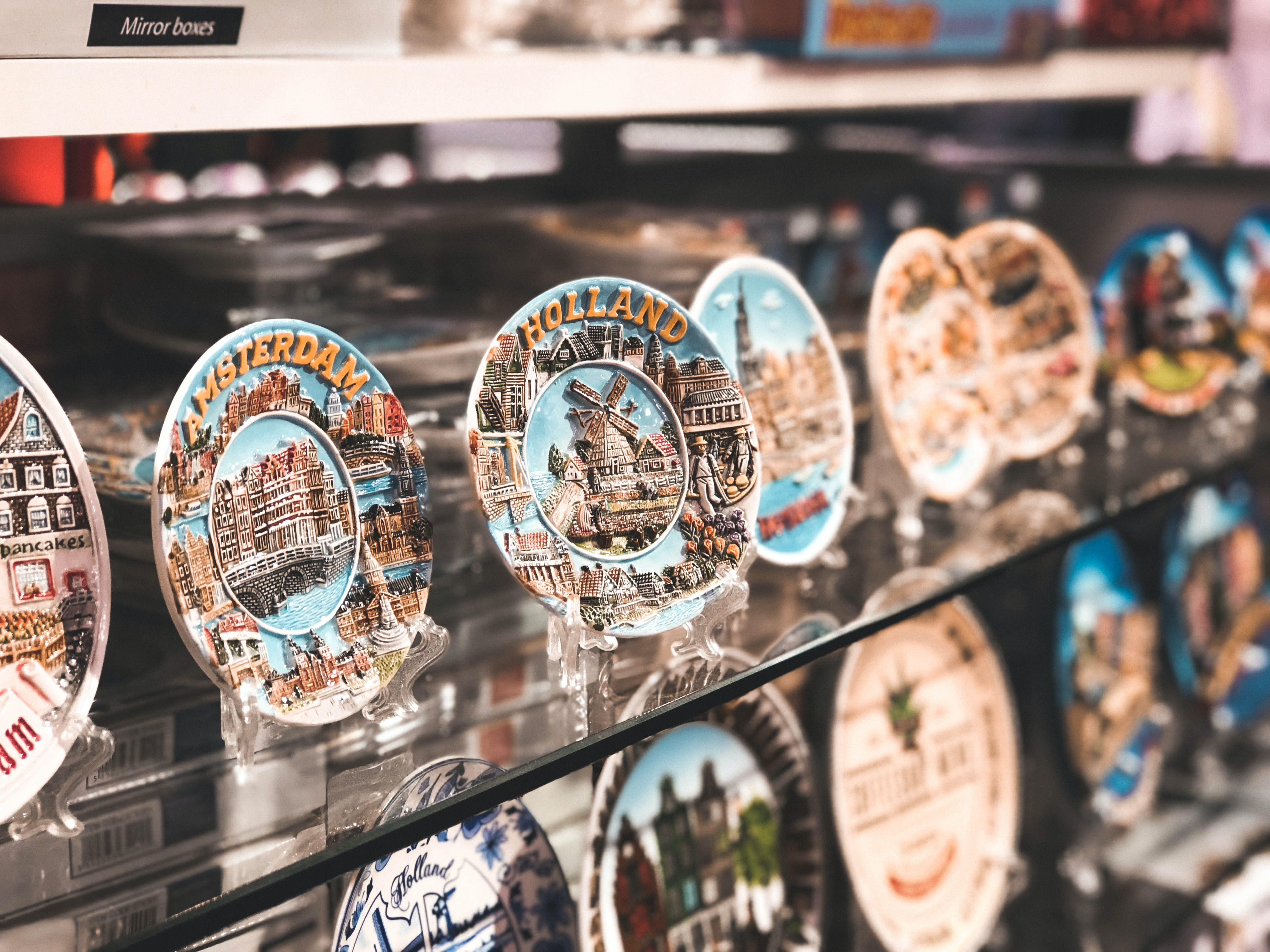 decorative plates display on glass shelf
