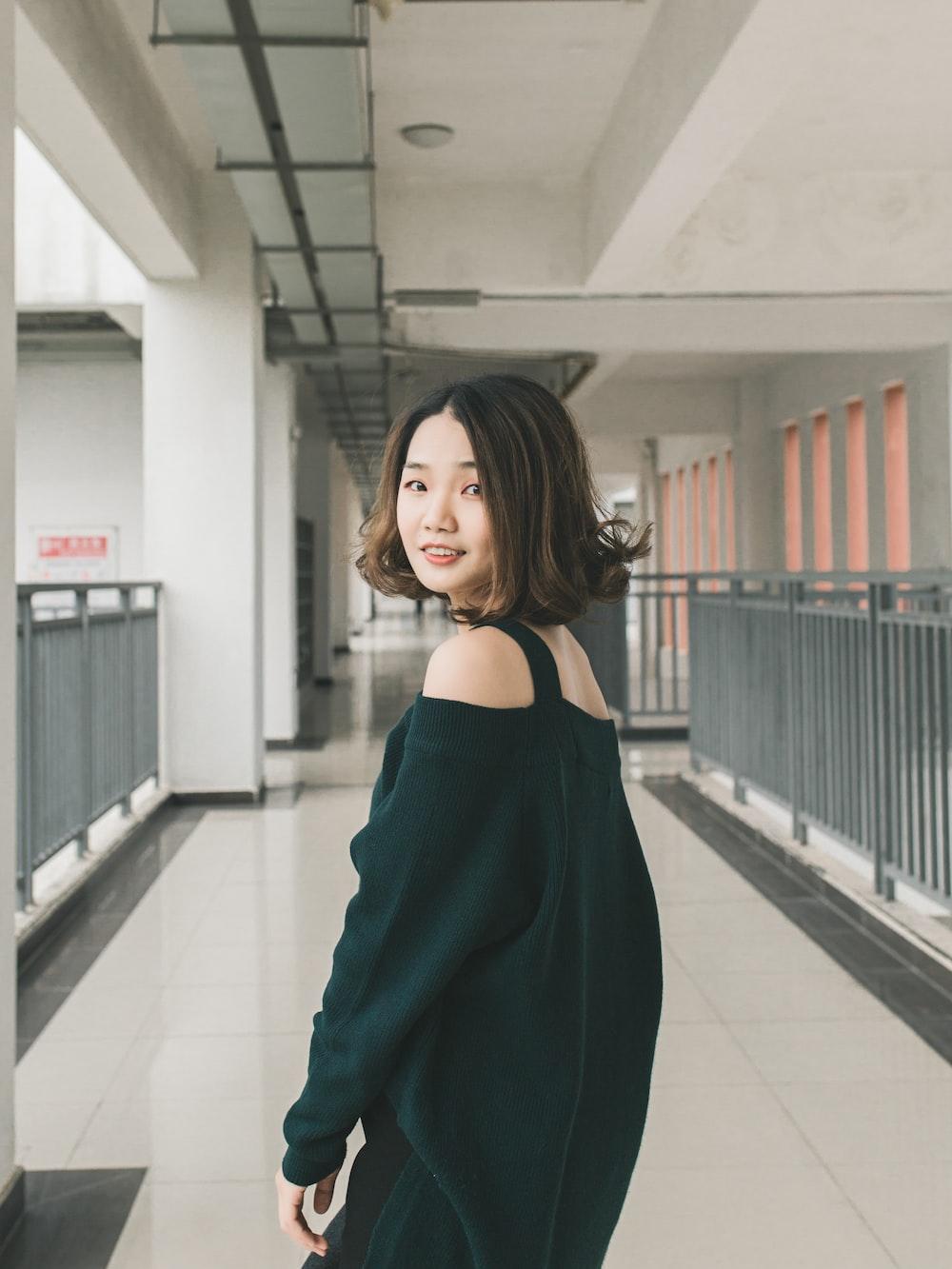 woman standing on hallway