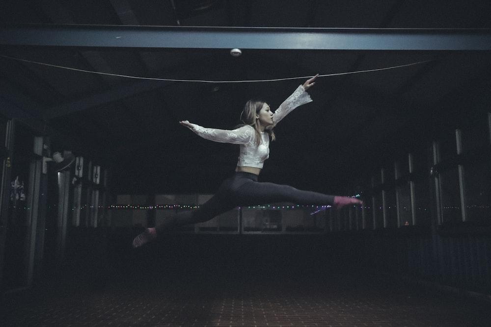 woman jumping inside room
