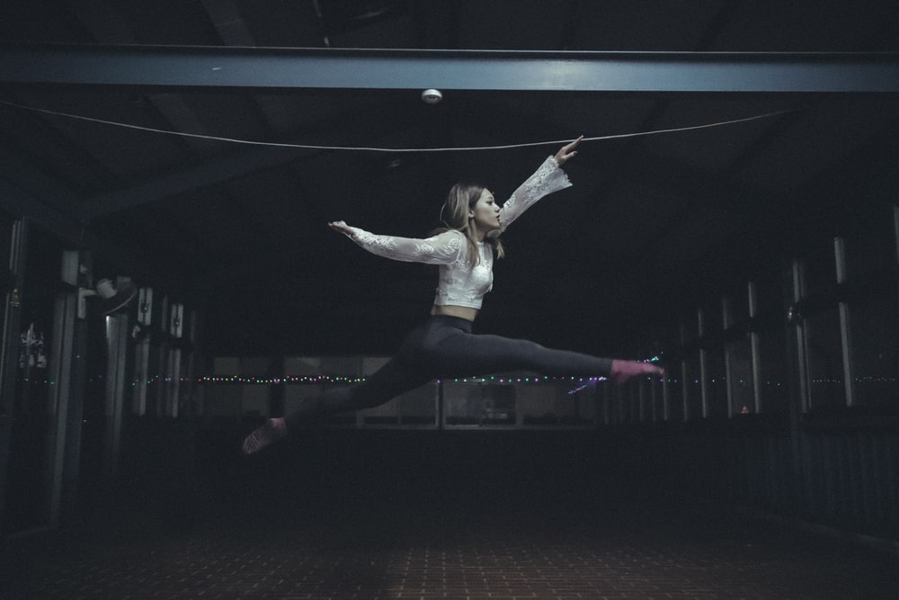 woman jumping inside room
