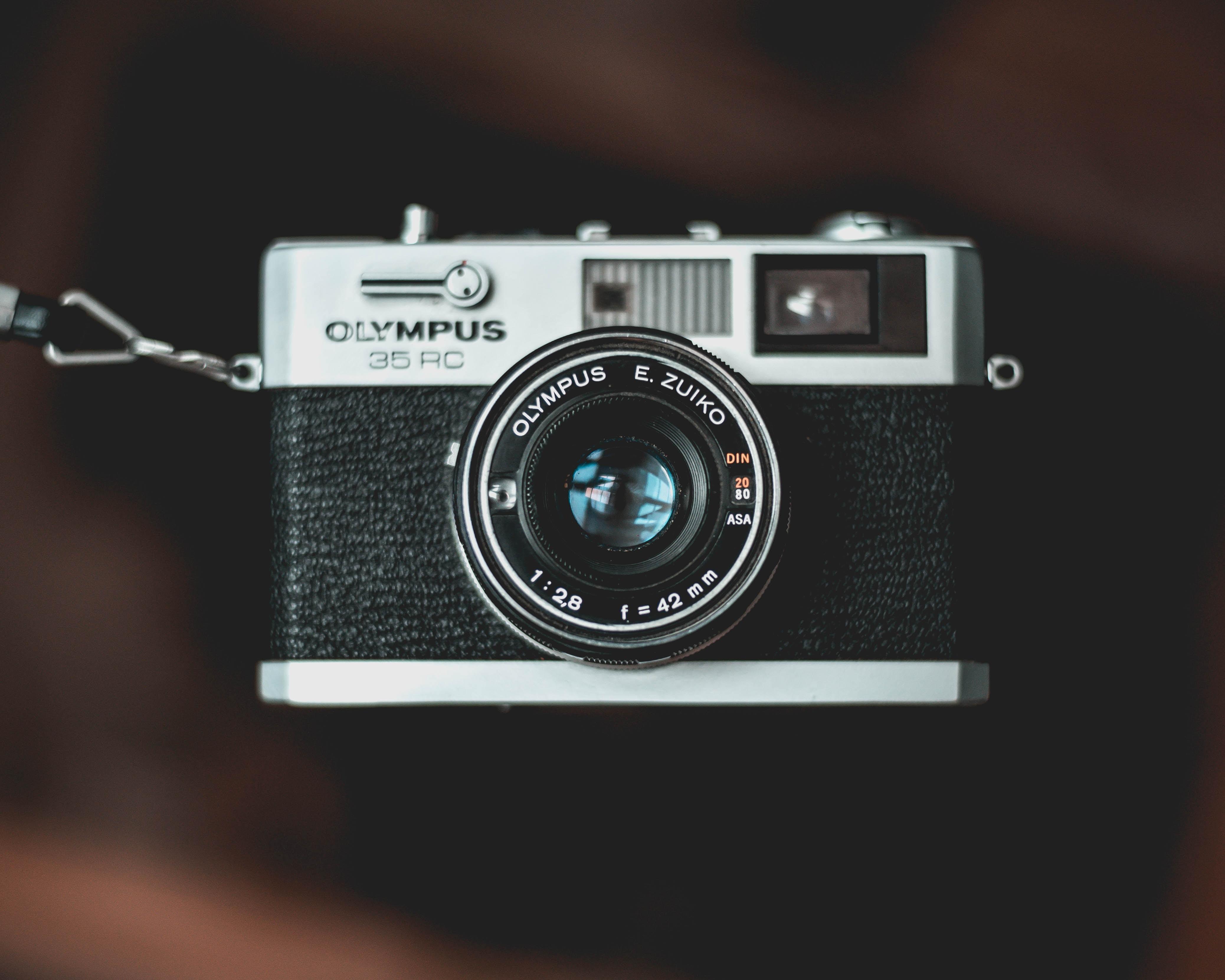 black and gray Olympus 35 RC camera