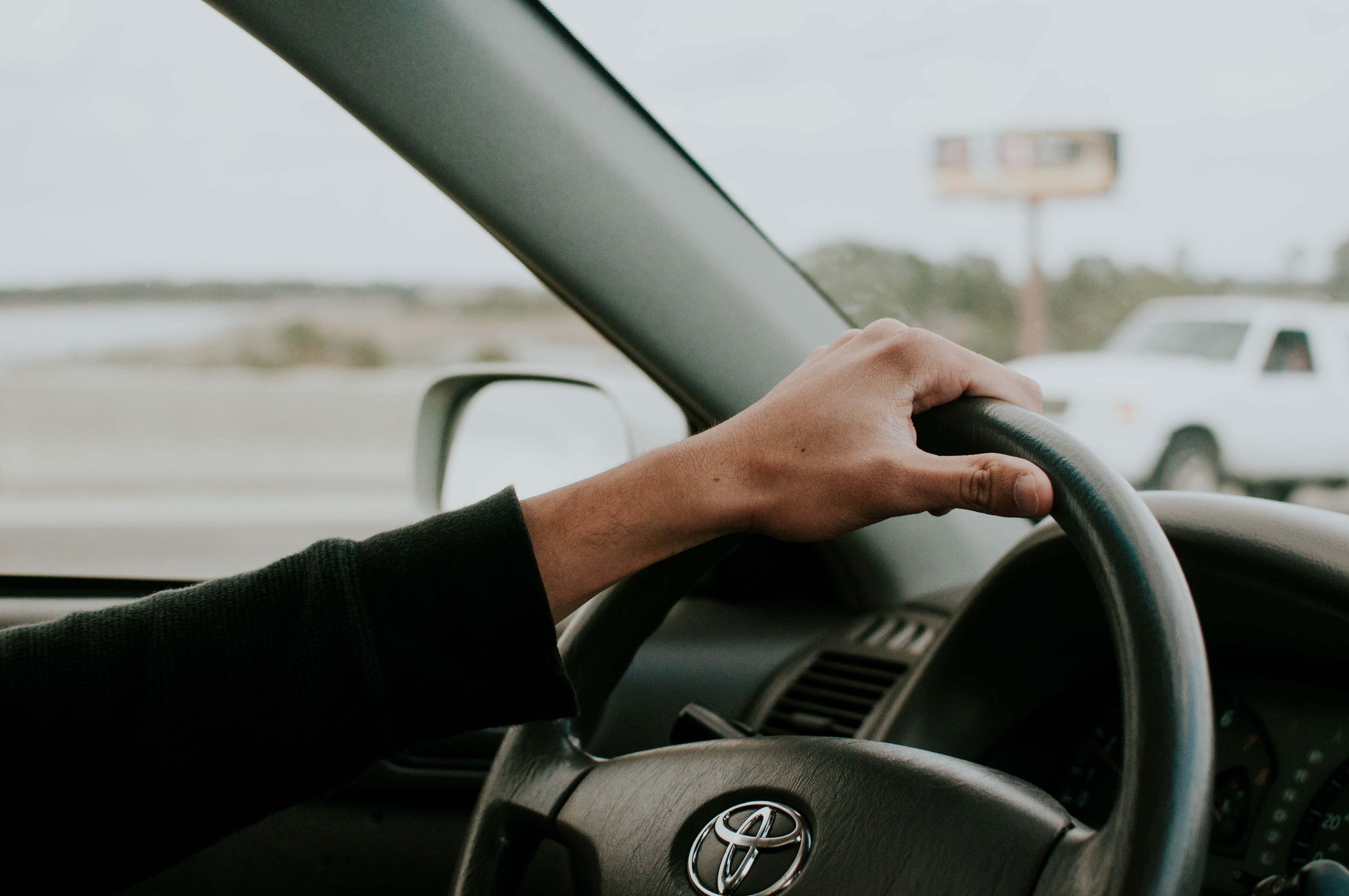 person driving Toyota car