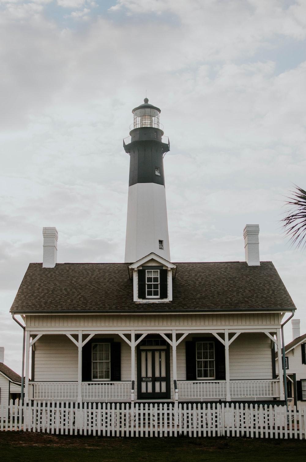 white lighthouse under white sky