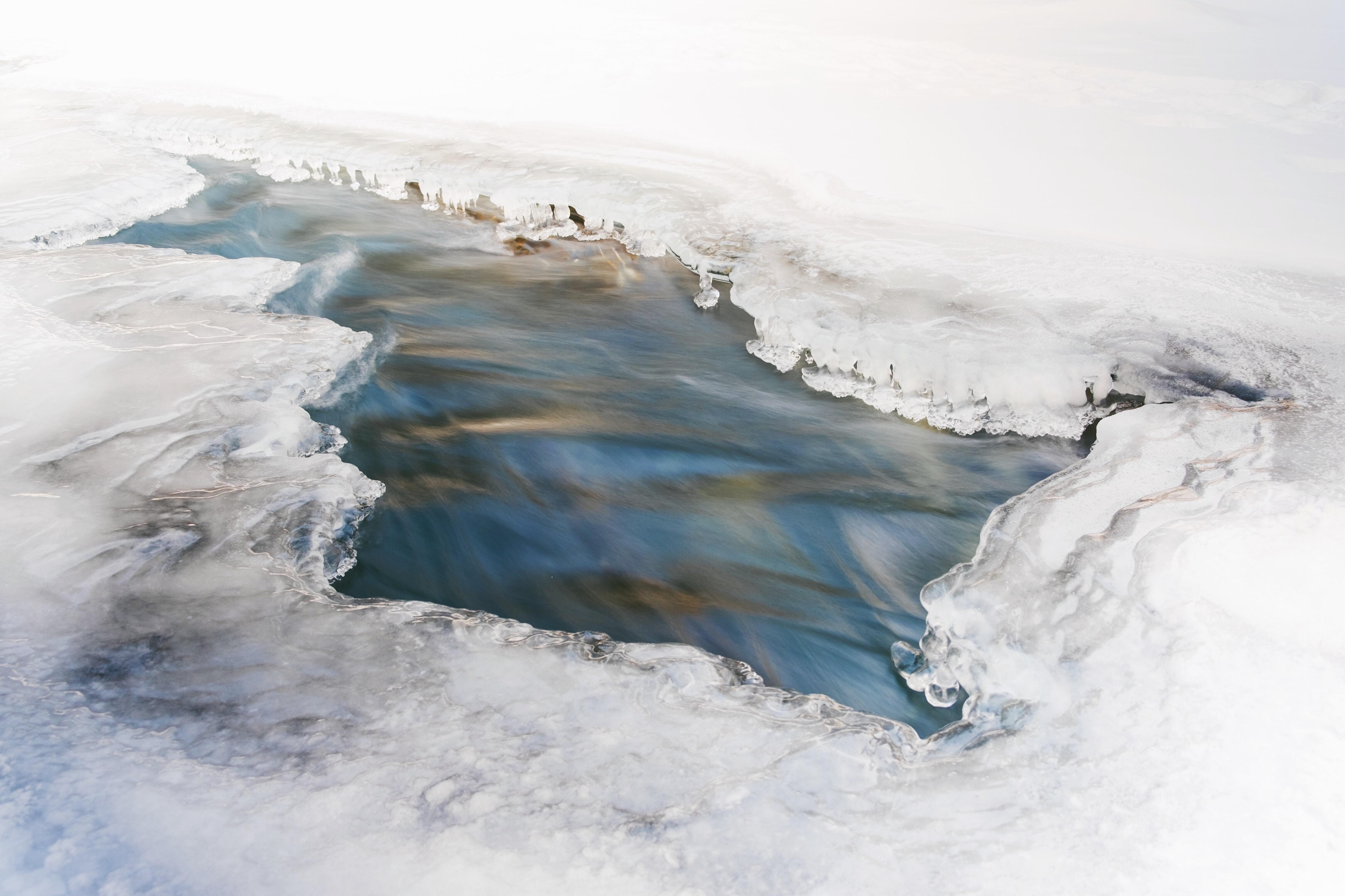 aerial photo of iceberg during daytime