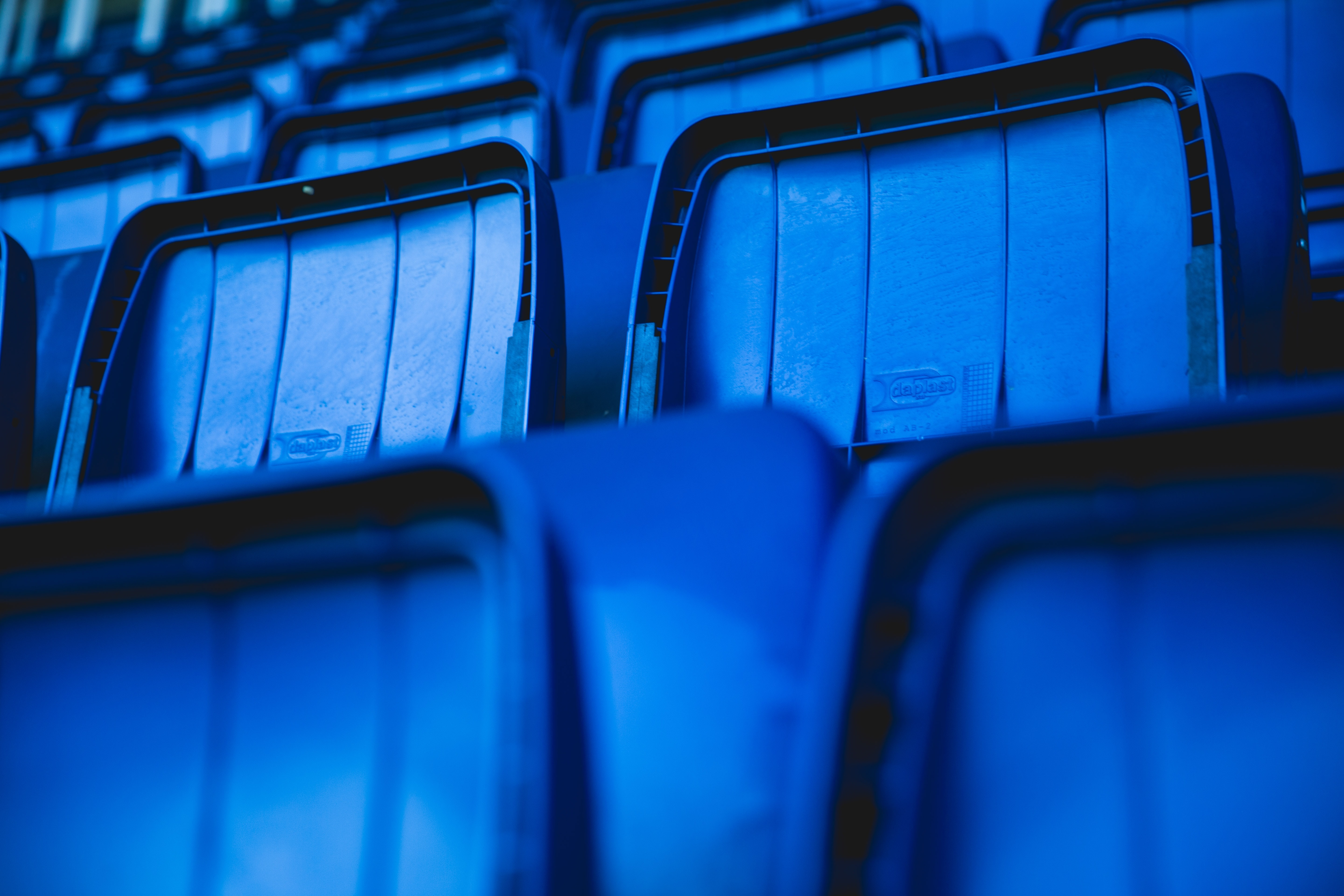 portrait photography of blue gang chair