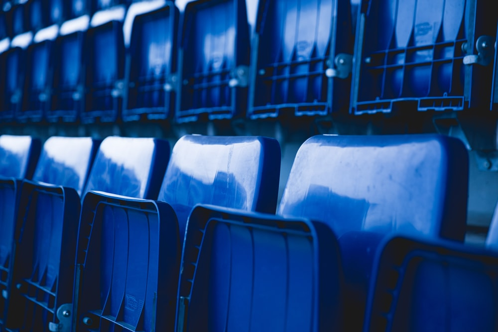 blue plastic gang chair lot inside the building