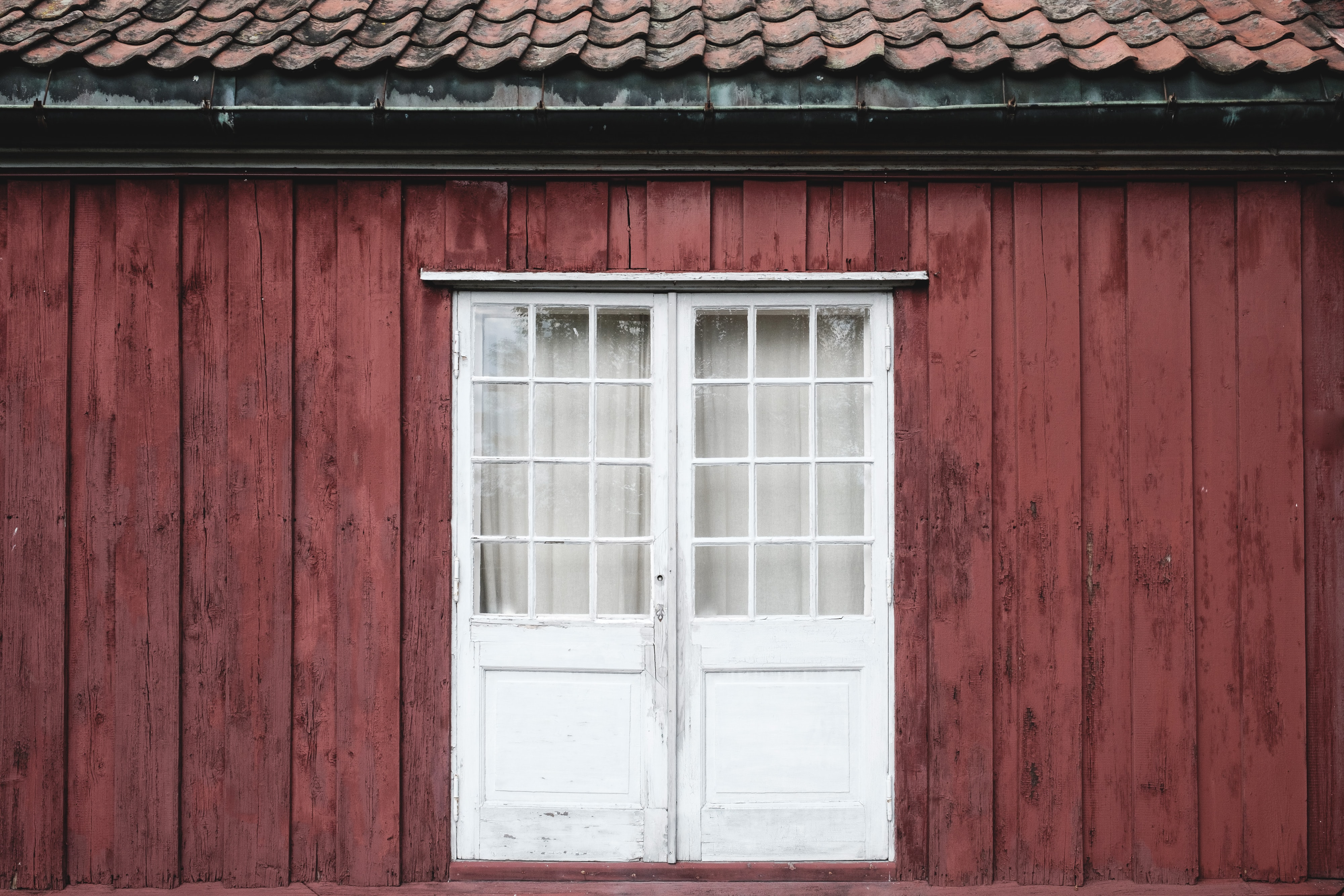 photo of closed white wooden window