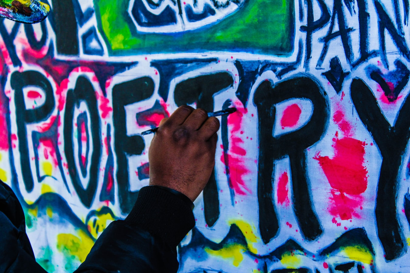 Person painting the word
