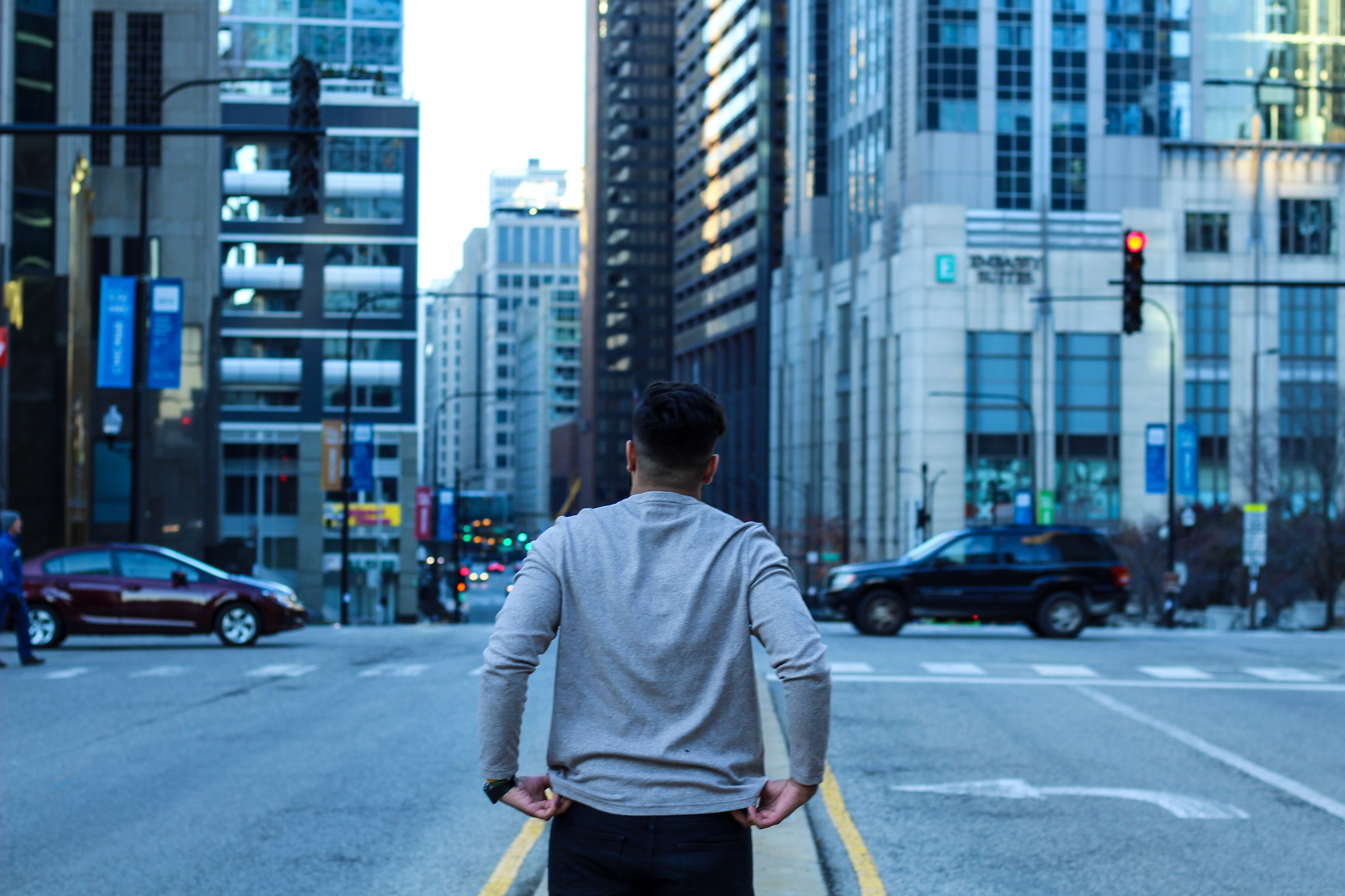 man walking in the middle of the street