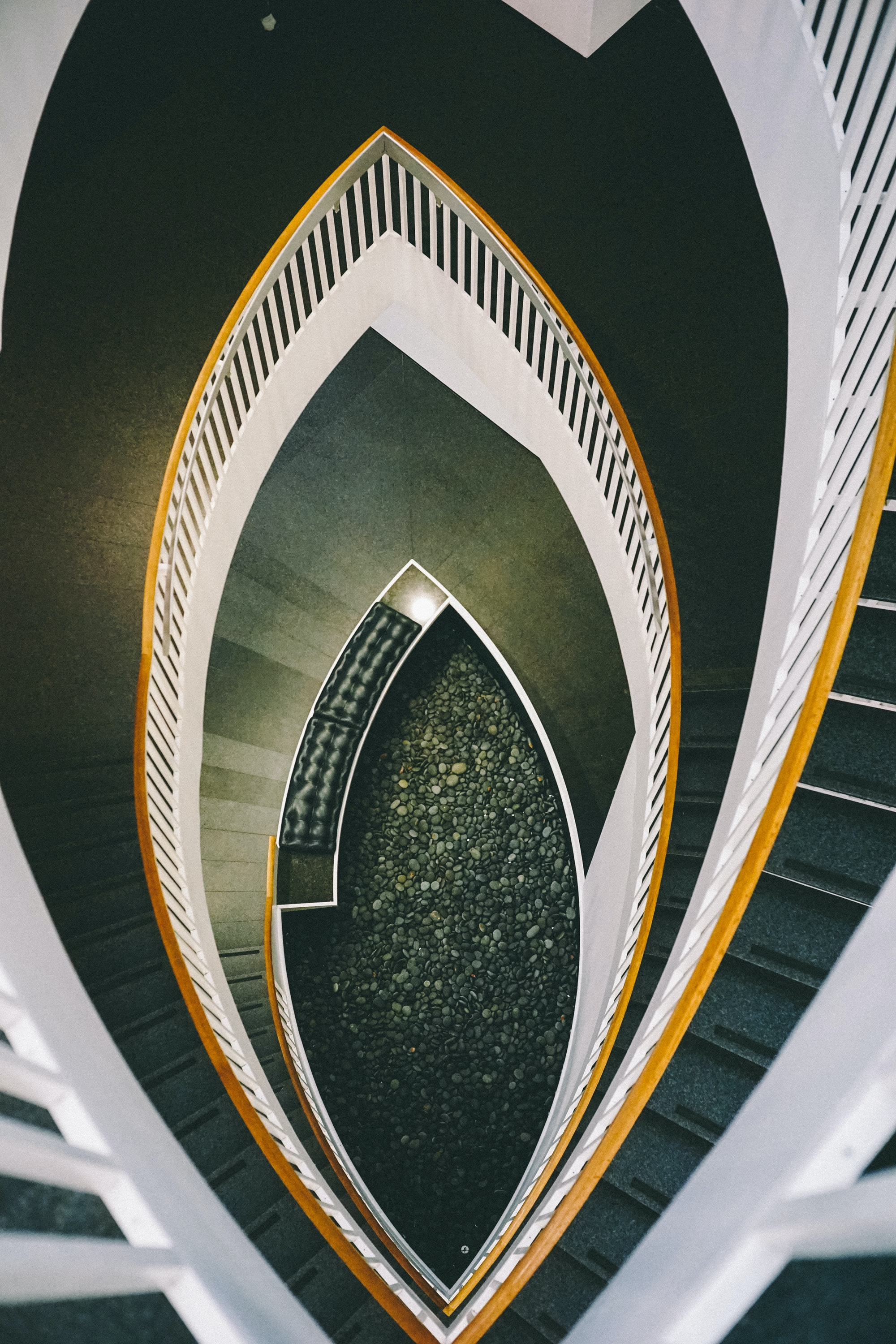 low-angle view of white spiral staircase
