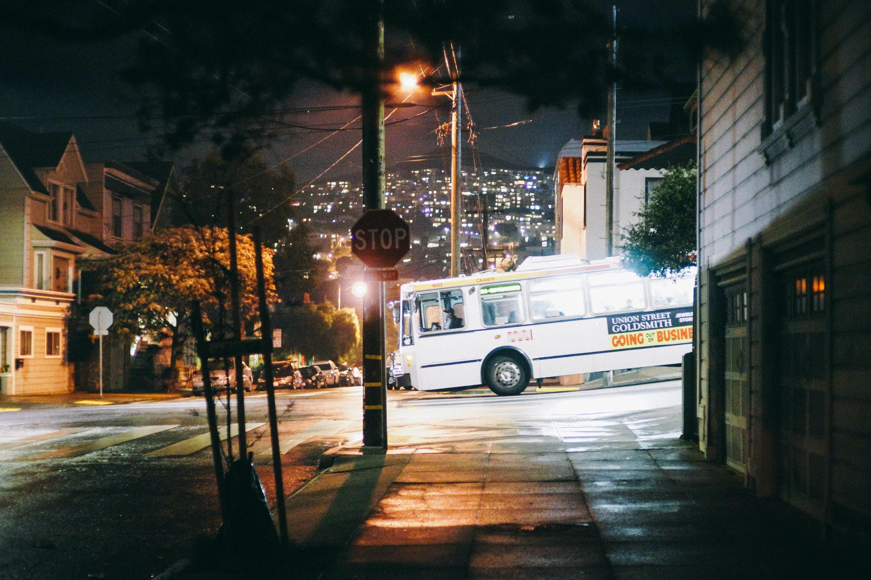 white bus near houses