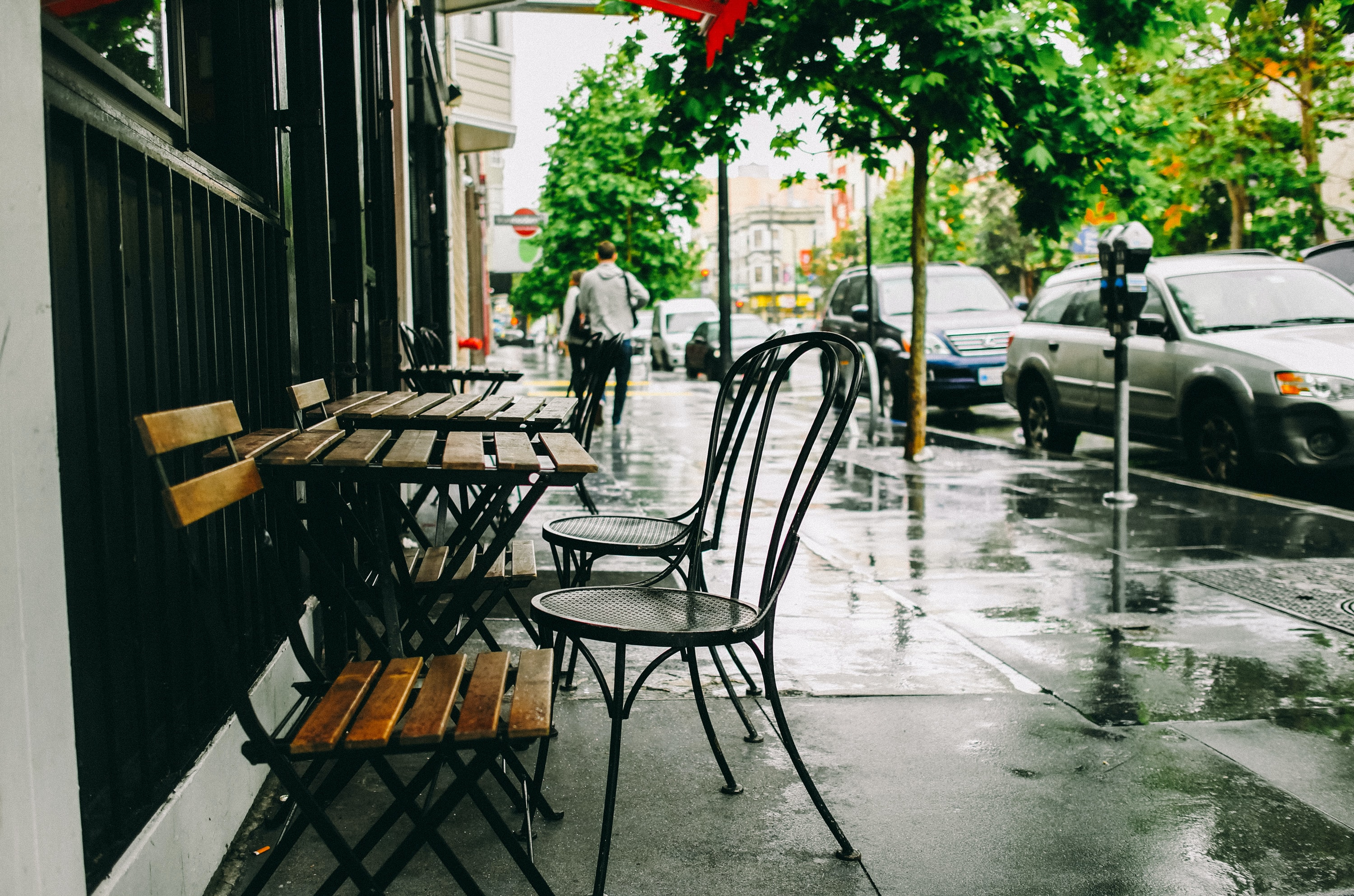 chairs and tables on sidewalk