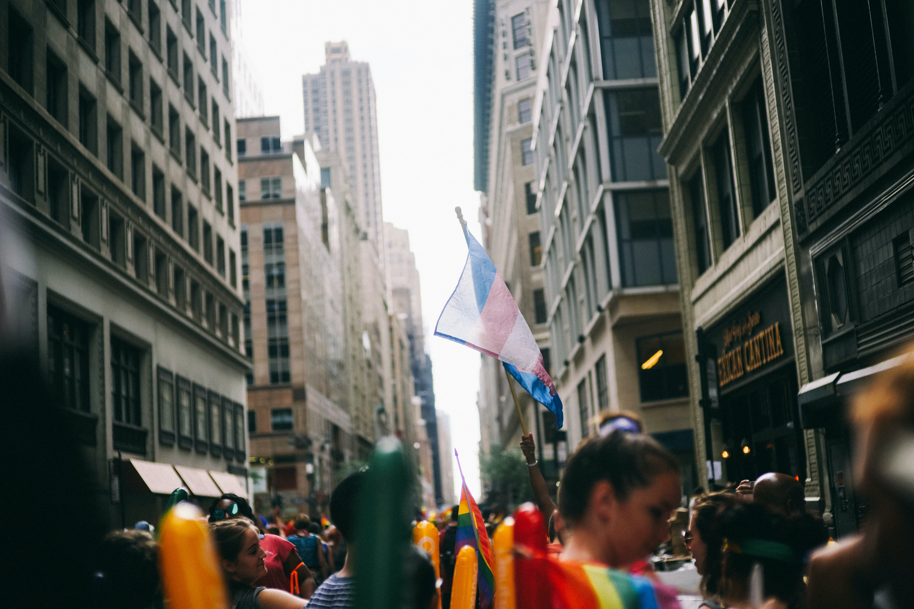 people on street holding flags