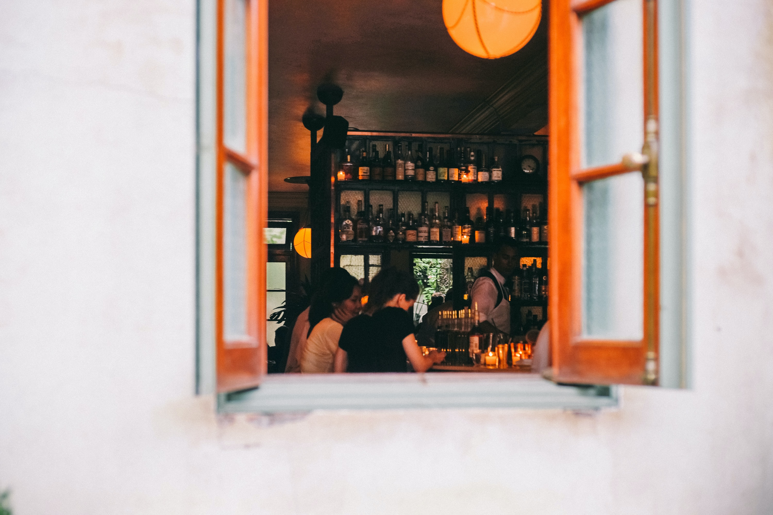 window of wine bar with people