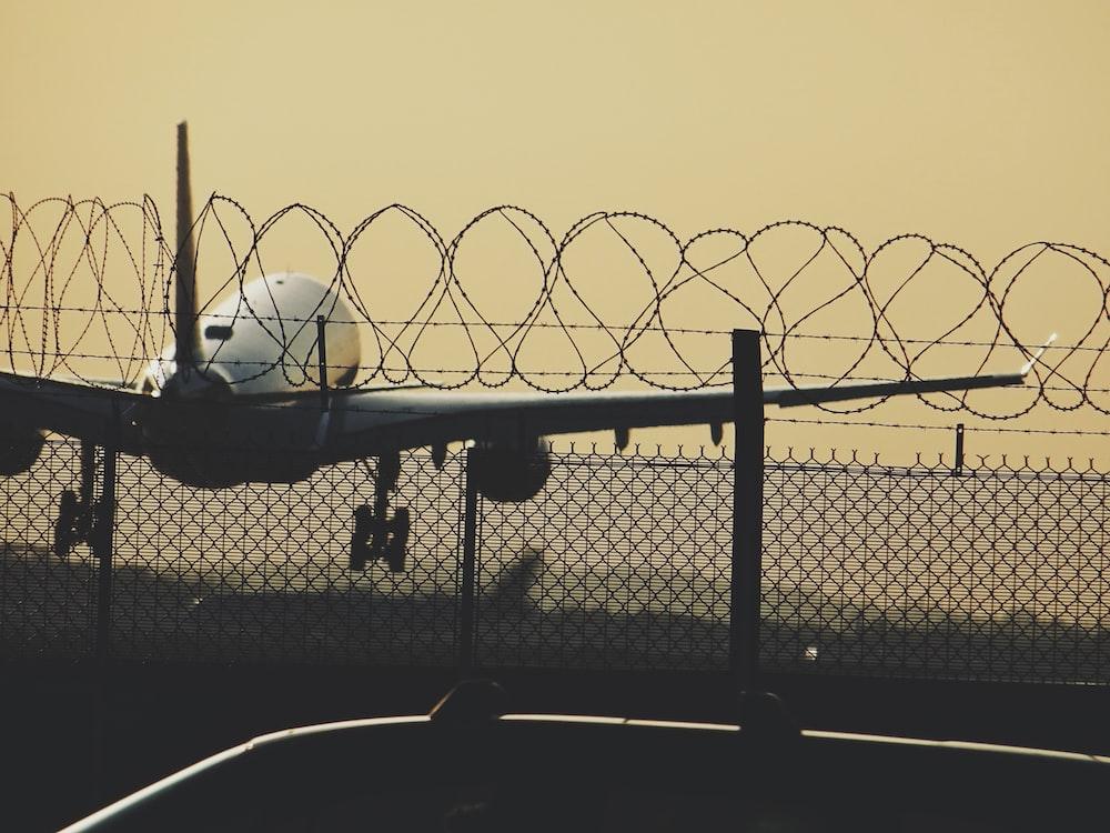 macro photography of white airplane
